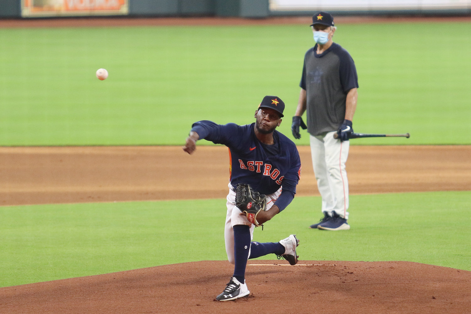 Houston Astros pitcher Enoli Paredes unleashes a pitch during batting practice at Minute Maid Park Sunday afternoon.