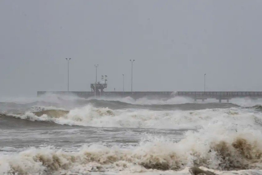 Tides rise at Bob Hall Pier in Corpus Christi as Hurricane Hanna approaches land on Saturday. A section of the Texas coast already reeling from thousands of coronavirus cases will continue to feel the effects of the storm, which was the first hurricane of the season.