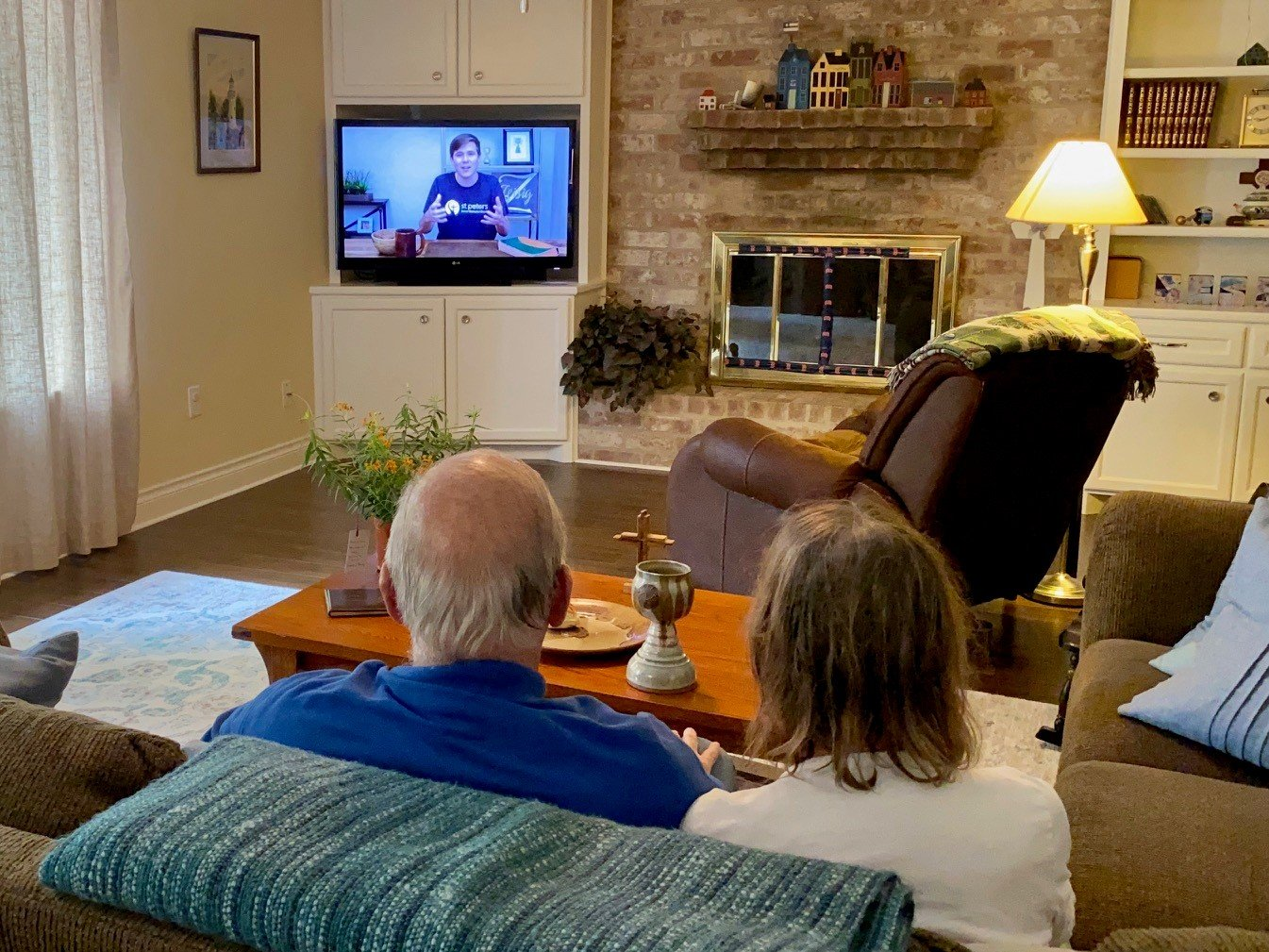Rev .Bob Johnson and his wife, Susan Johnson watching the St. Peter's United Methodist Church's West Campus live-stream services.