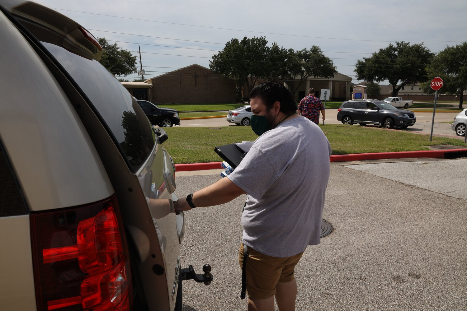 Katy ISD staff brought devices out to vehicles for curbside pick up on Monday, Aug. 17. About half of the district's student body will continue to take online classes through the Katy Virtual Academy after students are allowed to - tentatively - return to campuses Sept. 8.