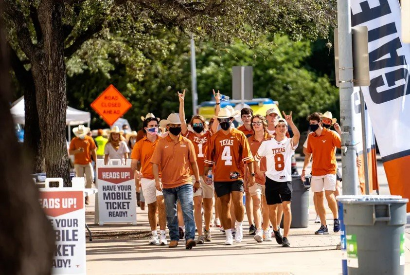 Fans walk toward the stadium for the first home football game of the season at the University of Texas at Austin. Students had to test negative for the coronavirus before attending the game. In counties where four-year college students make up at least 10% of the population, cases have grown 34% since Aug. 19, according to a Texas Tribune analysis. That's compared with 23% in counties with a smaller proportion of students.