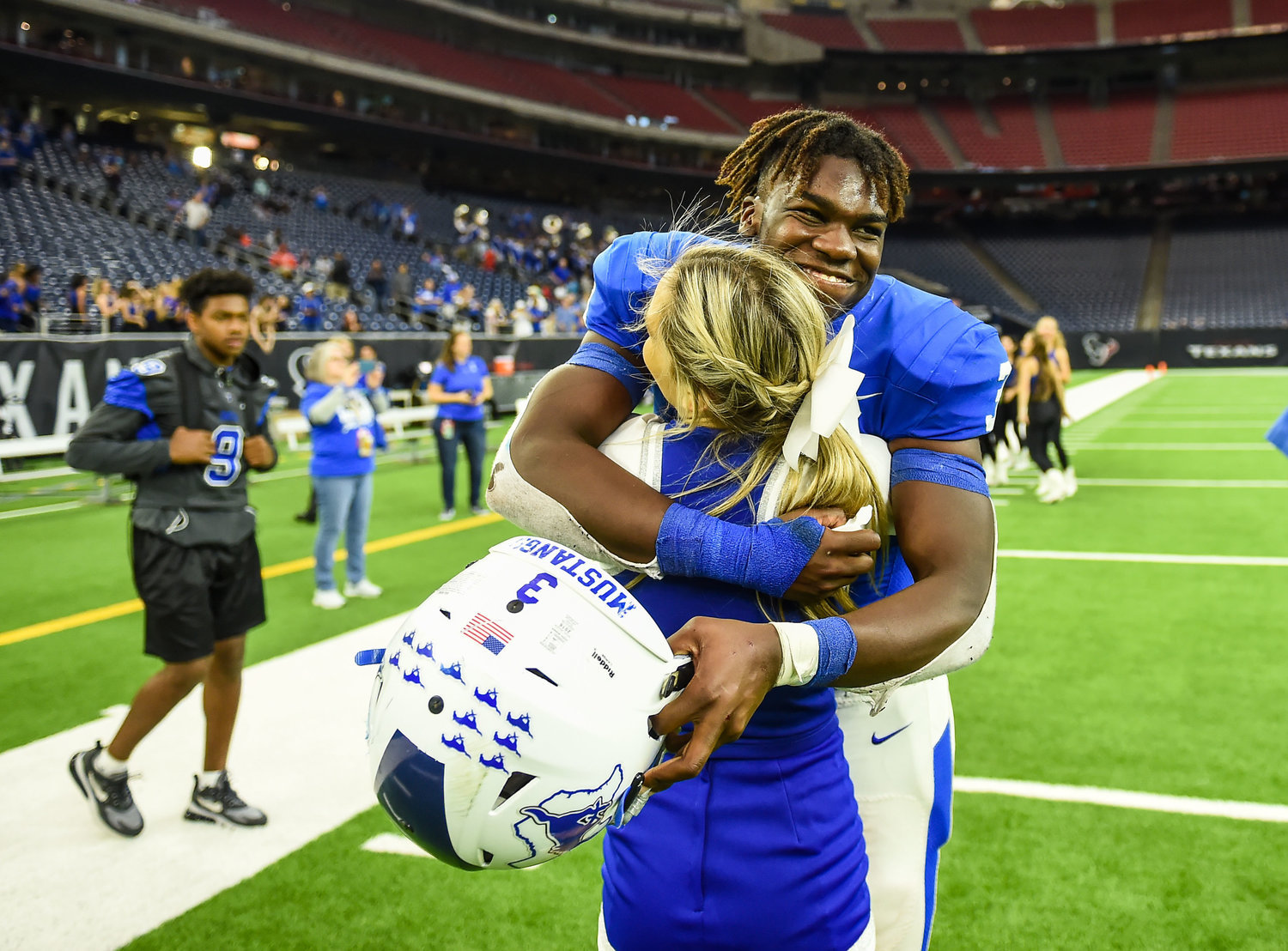 Houston, Tx. Dec 7, 2019: Taylor's Cj Tolbert (3) celebrates Taylors win with a cheerleader during the Regional Finals playoff game between Katy Taylor and Cy-Creek at NRG Stadium in Houston. (Photo by Mark Goodman / Katy Times)