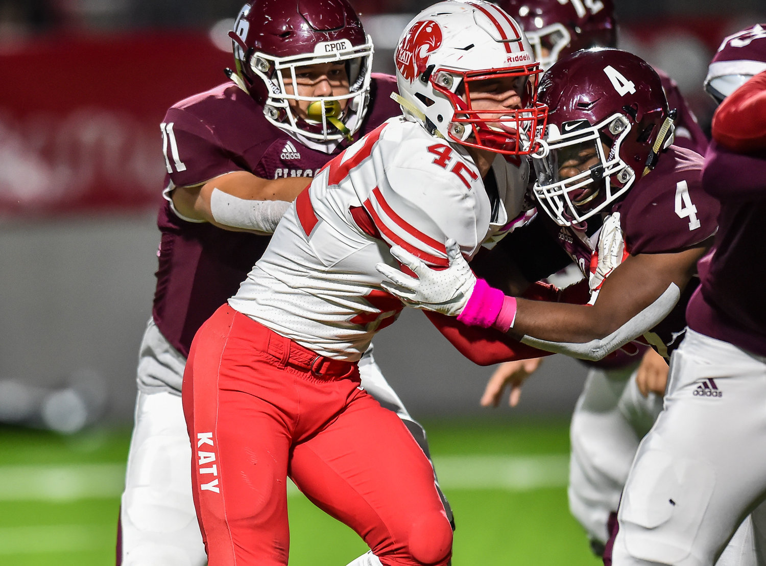 Katy, Tx. Oct. 25, 2019: Katy's Ty Kana (42) tries making his way around Cinco Ranch's GJ Kelly (4) during a conference game between Katy Tigers and Cinco Ranch Cougars at Legacy Stadium. (Photo by Mark Goodman / Katy Times)