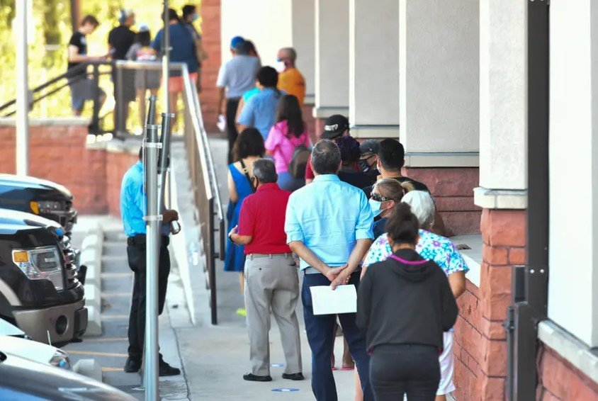 Voters waited outside of the Bexar County Elections Department in San Antonio to drop off their mail-in ballots, voter registration applications or be trained as poll workers on Oct. 5. The Texas Supreme Court ruled against several GOP officials who pushed to keep early voting to a two-week period during the pandemic.