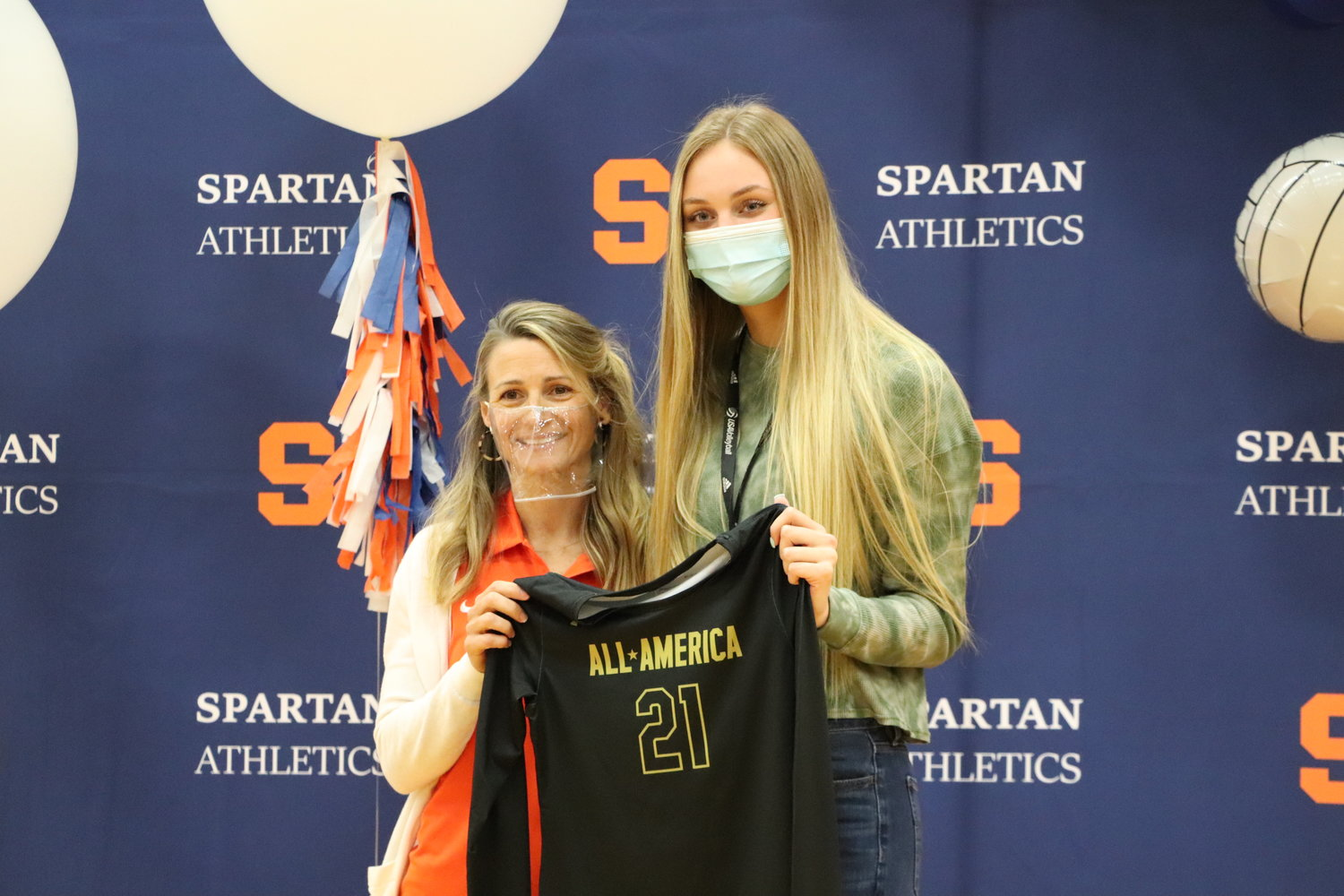 Seven Lakes senior outside hitter Ally Batenhorst and Spartans coach Amy Cataline pose for a photo after Batenhorst was awarded her Under Armour All-American jersey on Wednesday morning after being selected as one of 11 players to the first team.