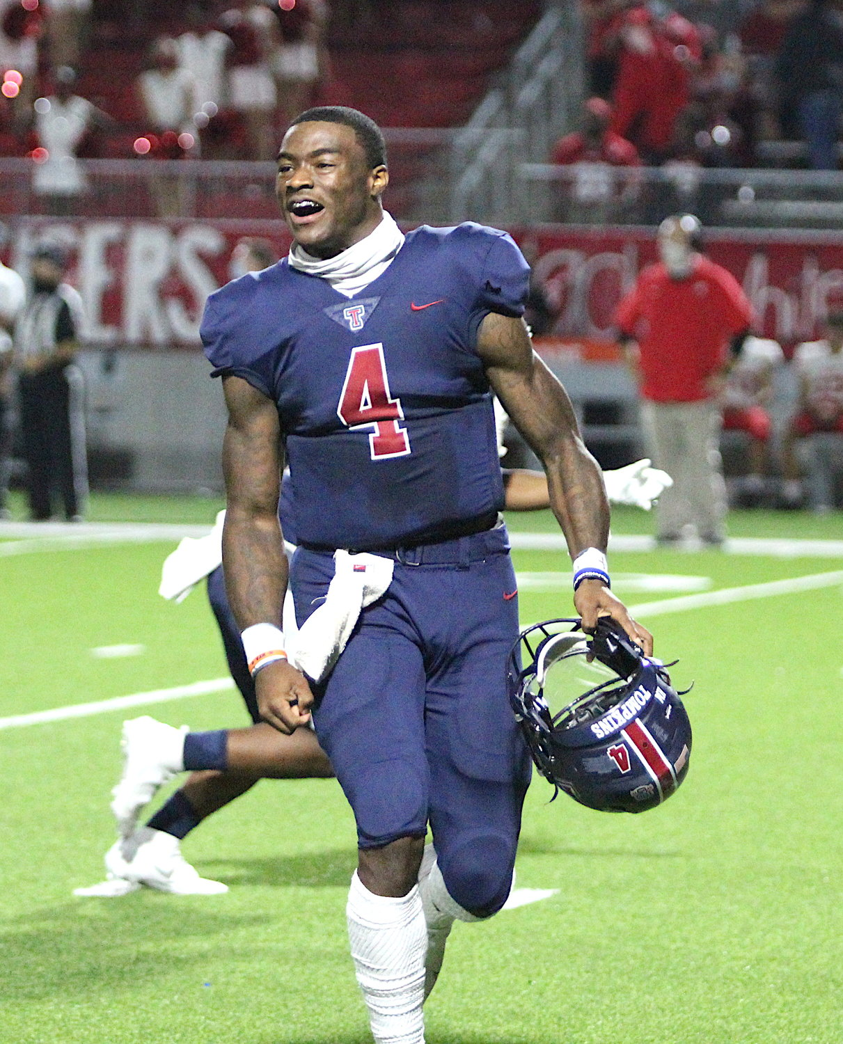 Tompkins senior quarterback Jalen Milroe celebrates after the Falcons' 24-19 win over Katy on Nov. 5 that snapped the Tigers' 75-game district winning streak.