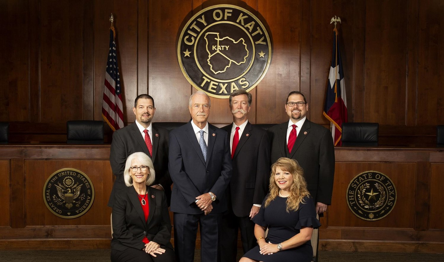 The Katy City Council is currently comprised of (from left to right) Council Member Janet Corte (front, left, seated), Council Member Jennifer Stockdick (front, right, seated) Mayor Pro Tem Chris Harris (back, left), Mayor Bill Hastings (blue tie) Council Member Durran Dowdle (handlebar mustache) and Frank Carroll (back, right). This will be one of the last meetings with this group of council members after Dowdle lost his bid for reelection to Rory Robertson during the Nov. 3 elections.