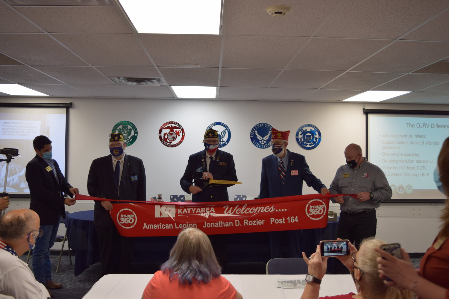 Representatives of American Legion Post 164 participate in a ribbon cutting for the Jonathan D. Rozier Legion Hall which was put on by the Katy Area Chamber of Commerce.