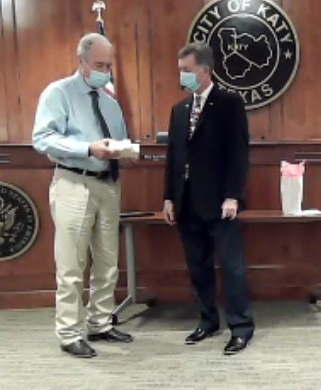 Katy Mayor Bill Hastings (left) presents a plaque to former council member Durran Dowdle (right) who has served the city for more than a decade through various boards and as a council member and Mayor Pro Tem. Dowdle served on council during the terms of three mayors, Fabol Hughs, Chuck Brawner and Hastings.