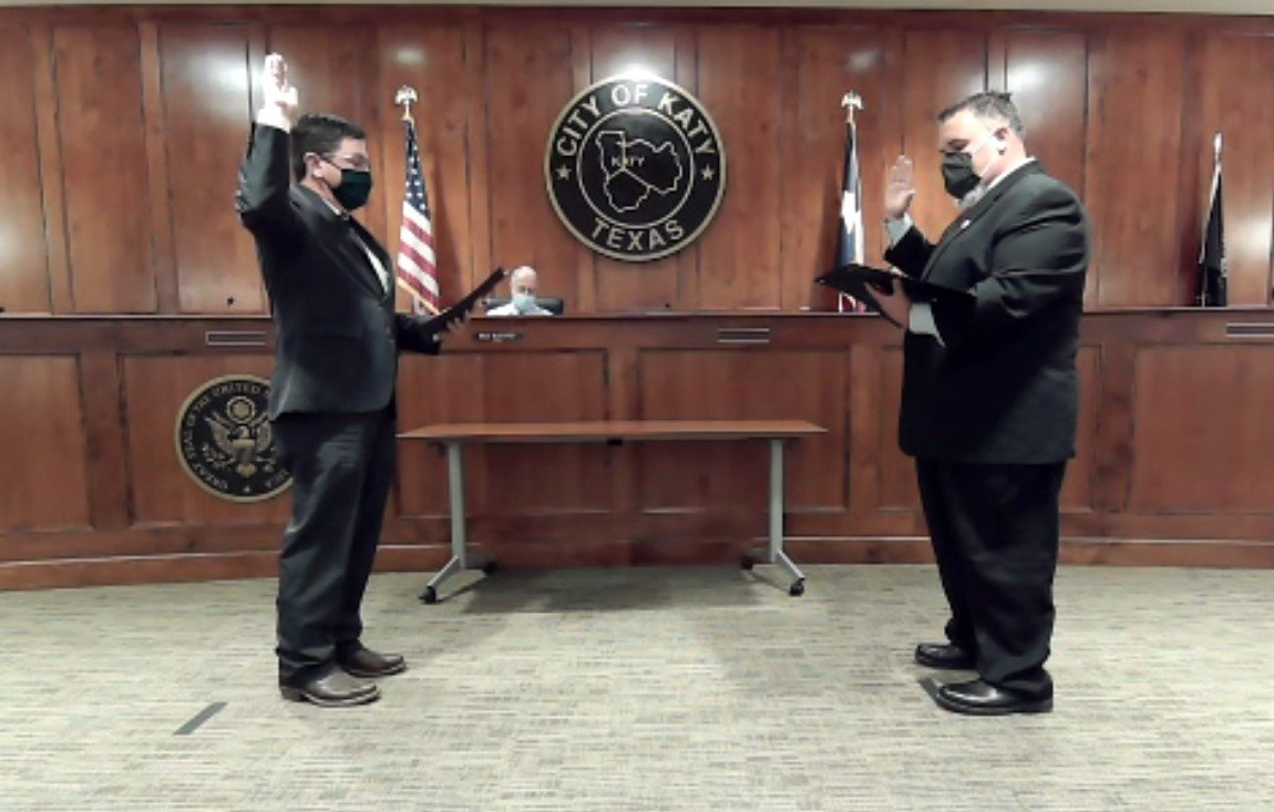 Newly-elected Ward B Katy City Council Member Rory Robertson is sworn in by City of Katy Municipal Court Judge Jeffrey Brashear during the semi-virtual Katy City Council meeting held Nov. 17. Incumbent council members Chris Harris and Janet Corte were sworn in during separate ceremonies earlier in the day in order to limit the number of people in council chambers due to COVID-19 concerns.