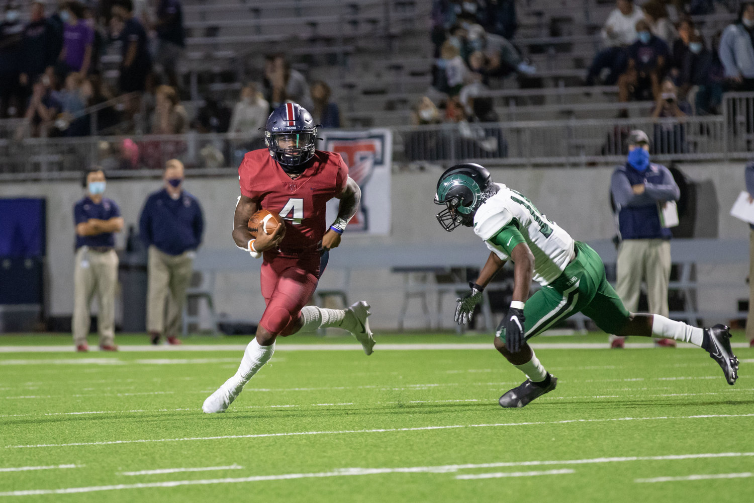 Tompkins quarterback Jalen Milroe eludes defenders during the Falcons' win over Mayde Creek on Thursday evening at Legacy Stadium.