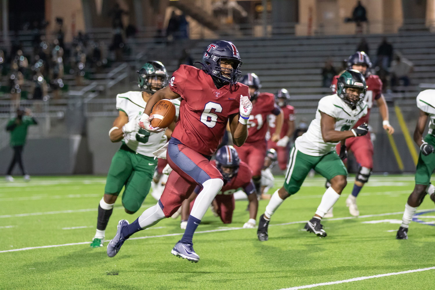 Tompkins running back Marquis Shoulders runs for a touchdown during the Falcons' win over Mayde Creek on Thursday evening at Legacy Stadium.