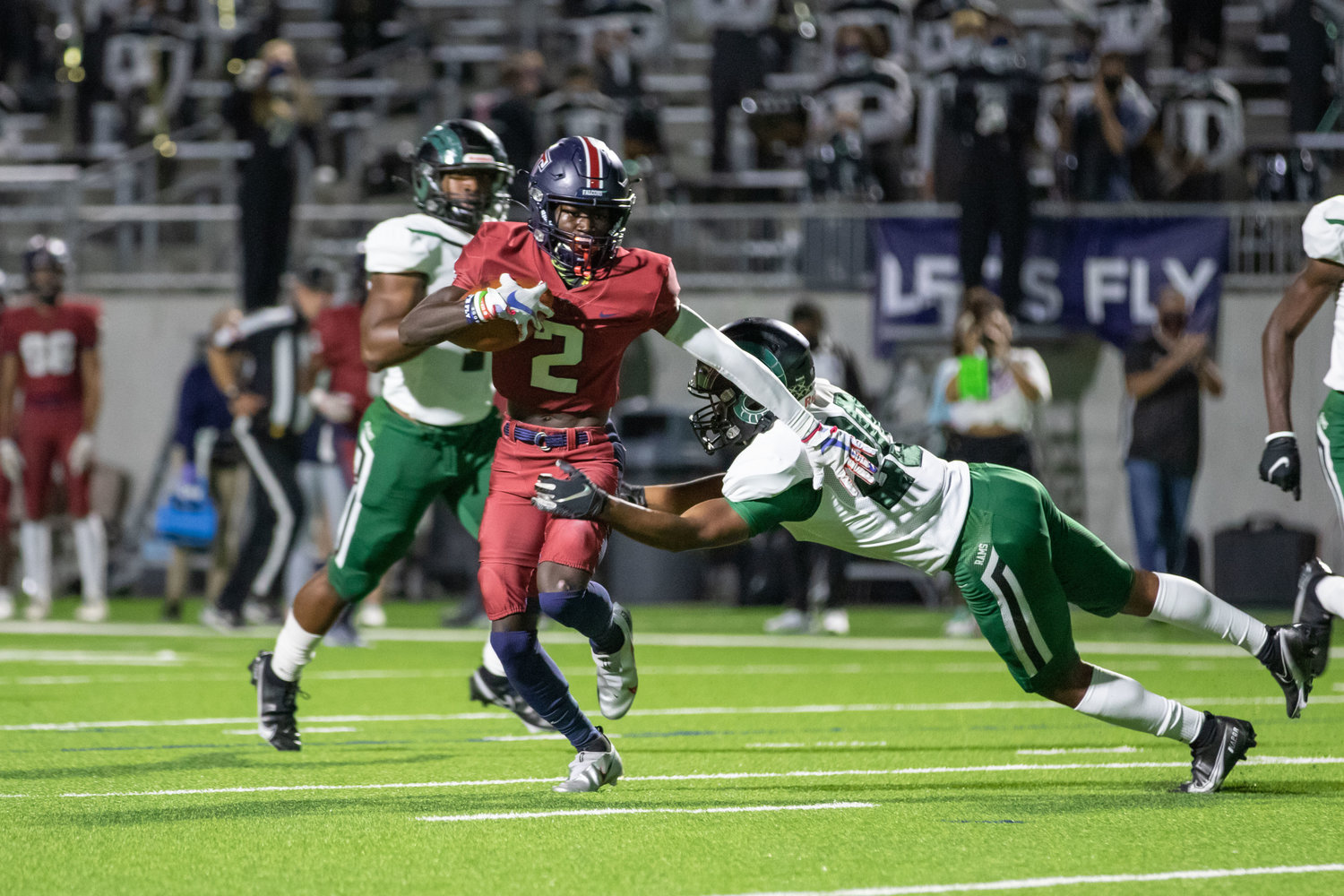 Tompkins receiver Joshua McMillan II makes a catch-and-run during the Falcons' win over Mayde Creek on Thursday evening at Legacy Stadium.