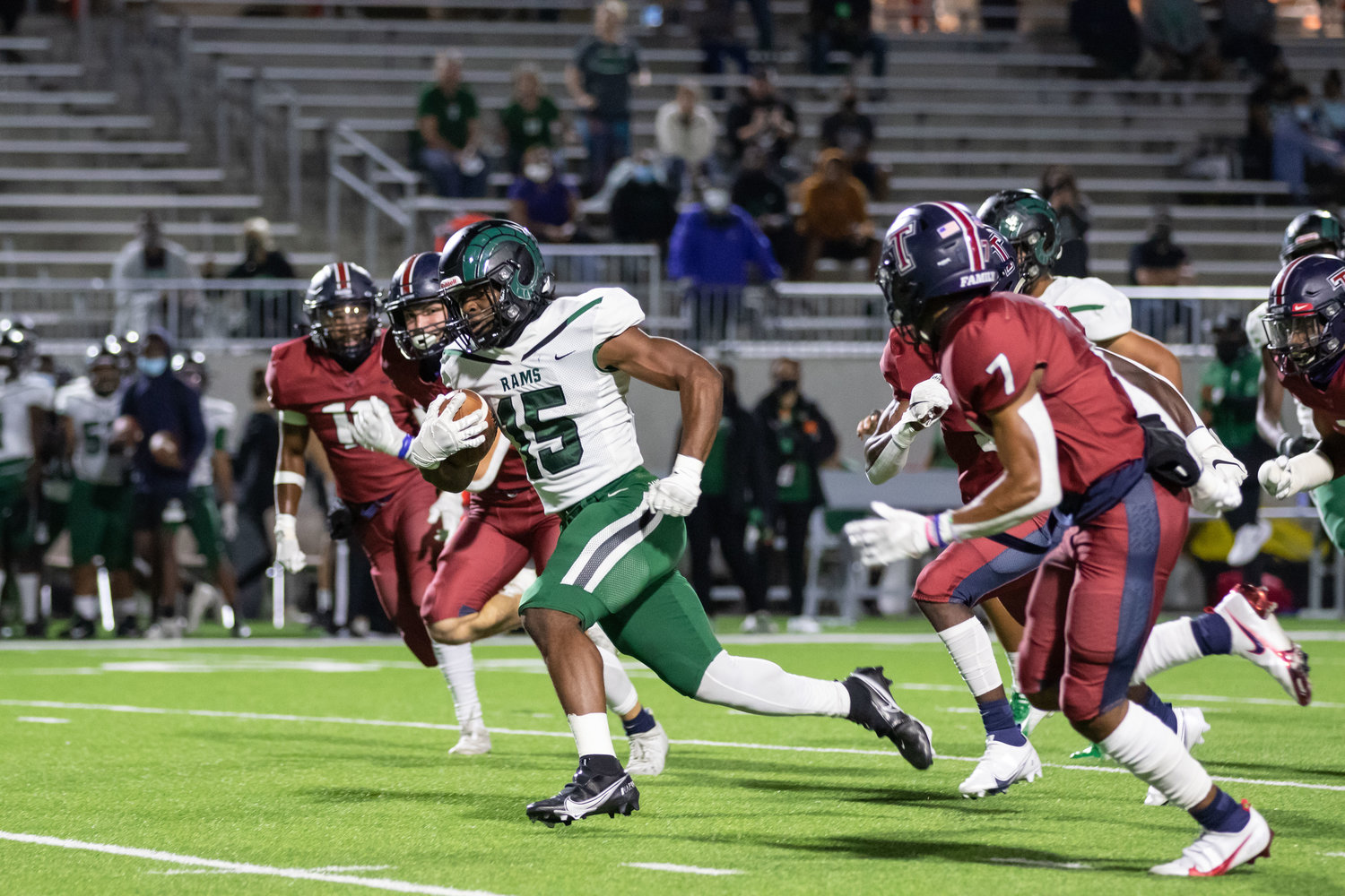 Mayde Creek running back Julius Loughridge gains separation from defenders during Tompkins' win over Mayde Creek on Thursday evening at Legacy Stadium.