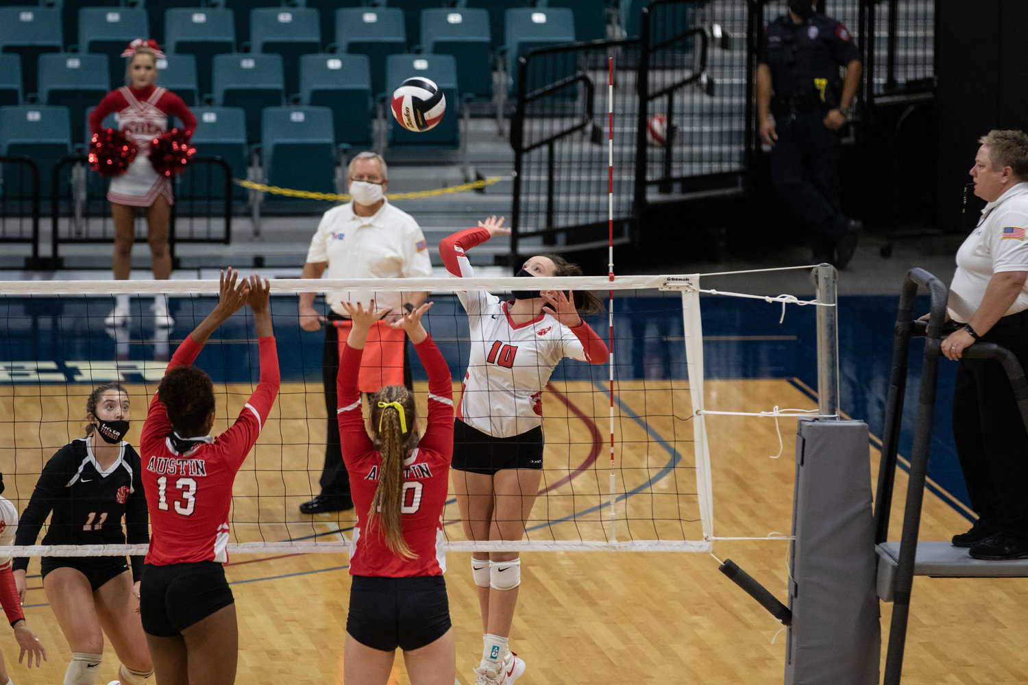 Katy High senior Abby Sherman goes up for a swing during the Tigers' sweep of Fort Bend Austin in their Class 6A bi-district playoff match Friday at the Merrell Center.