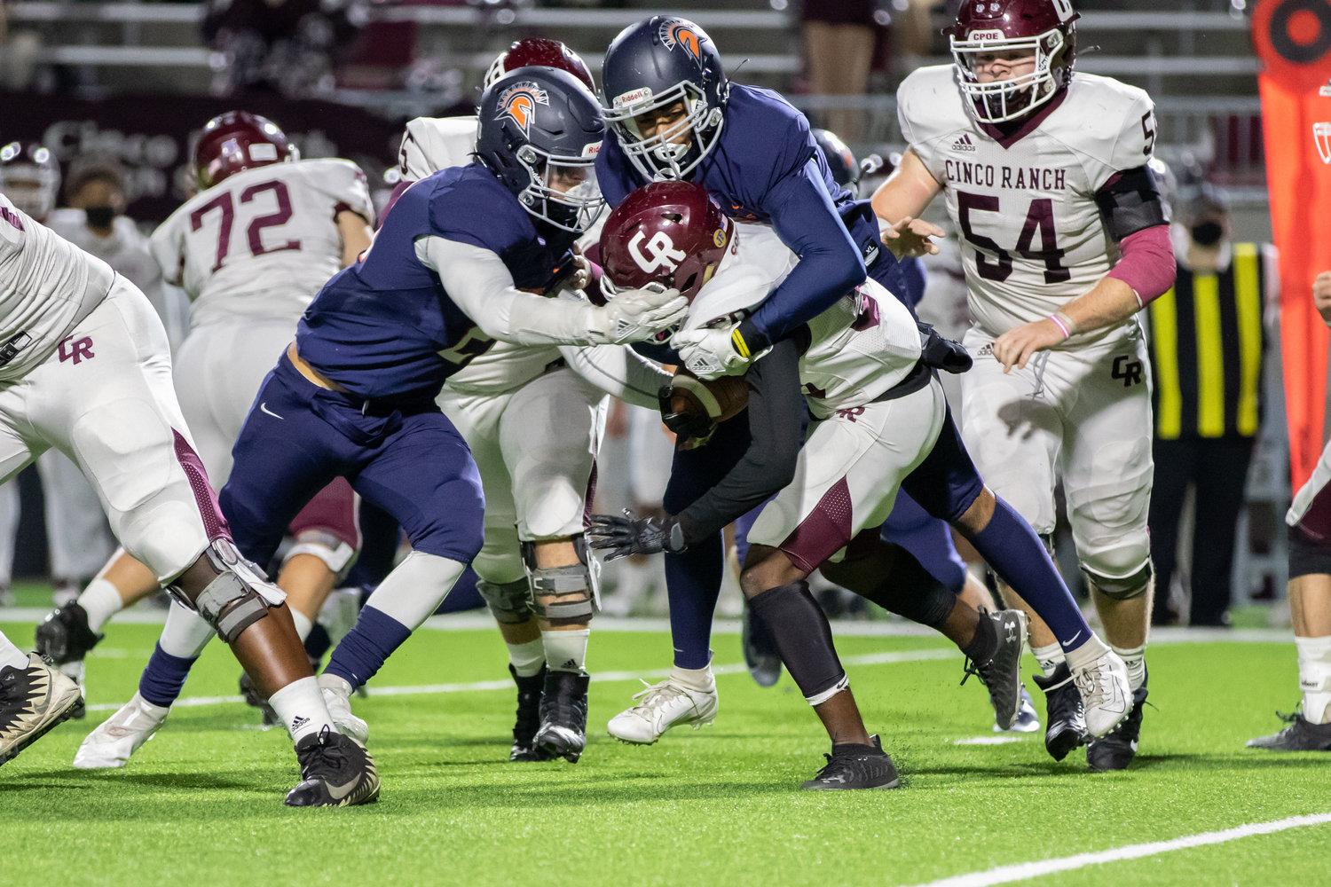 Seven Lakes defenders take down a Cinco Ranch ballcarrier during the Spartans' win over Cinco Ranch on Dec. 4 at Legacy Stadium.