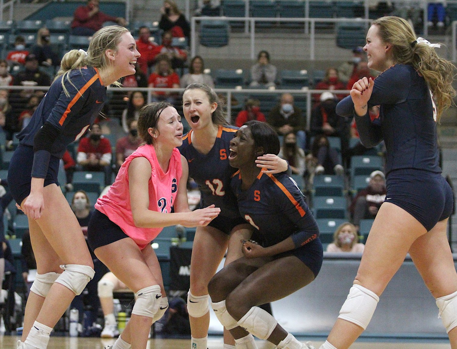 Seven Lakes senior Ally Batenhorst (front left) and junior Casey Batenhorst (front right) are enjoying the Spartans' remarkable run to the Class 6A state volleyball final. Ally is returning to the state final after making it with her older sister, Dani, in 2017. Now with younger sister Casey, she's hoping the second time can bring home a state title.