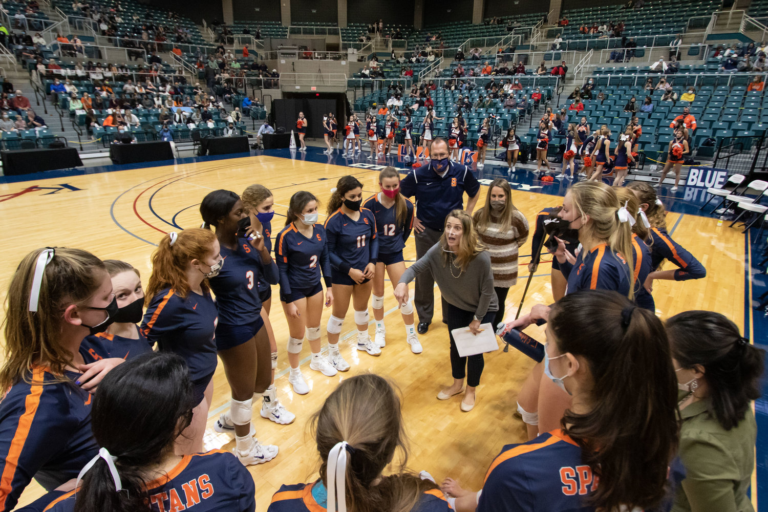 Seven Lakes coach Amy Cataline talks to her team during the team's Class 6A state semifinal match against San Antonio Reagan on Dec. 7 at the Merrell Center.