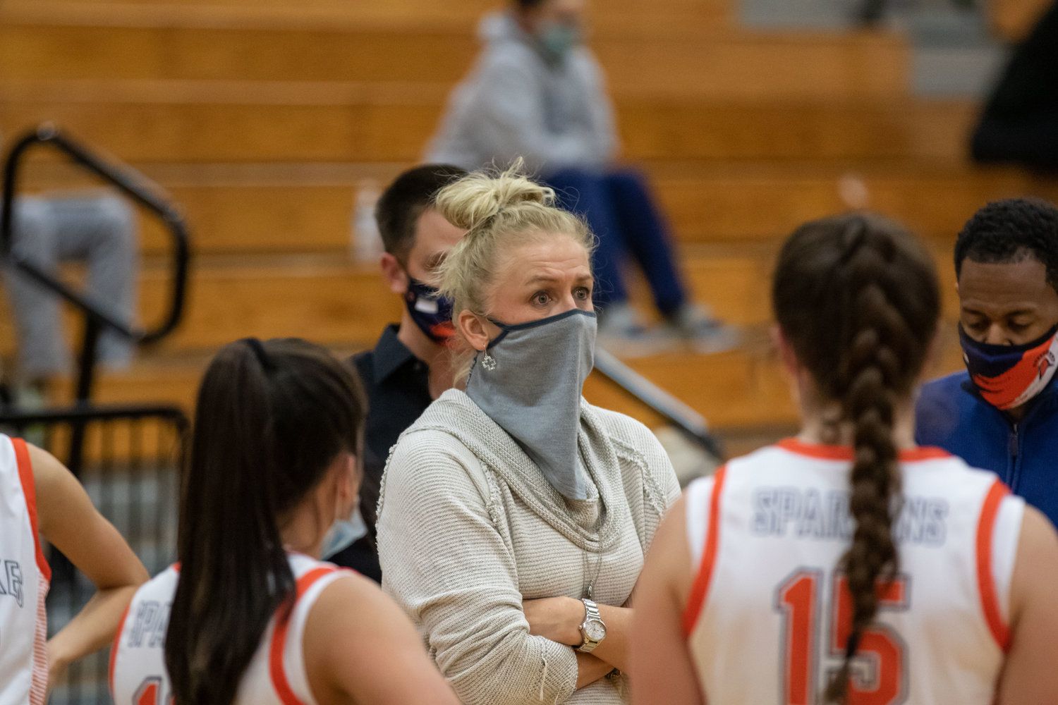 Seven Lakes coach Angela Spurlock talks to her players during a timeout during a game against George Ranch on Dec. 14 at Seven Lakes High.