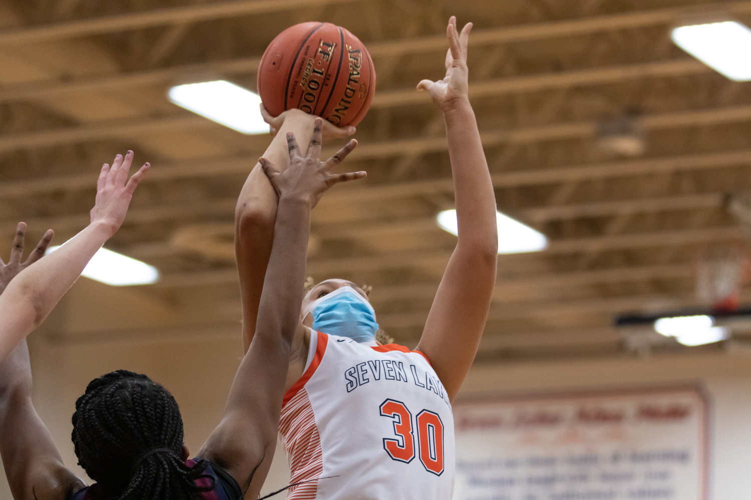 Seven Lakes freshman forward Justice Carlton goes up for a shot during a game against Tompkins on Tuesday, Dec. 29, at Seven Lakes High.