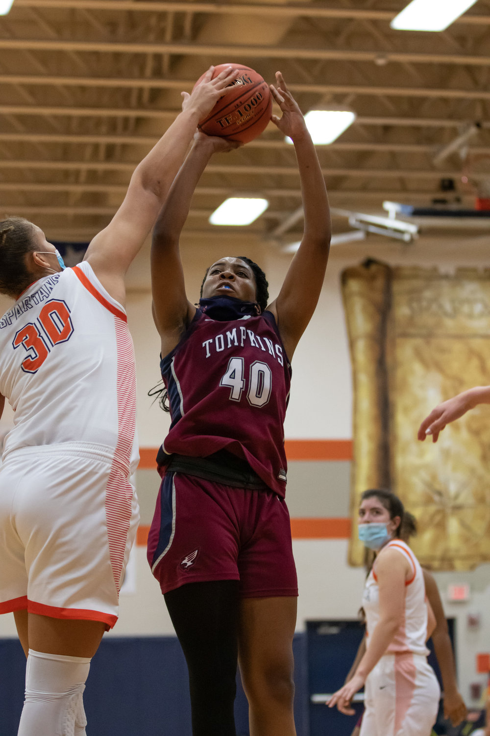Seven Lakes freshman Justice Carlton blocks Tompkins senior Ashley Ngene's shot during their game Tuesday, Dec. 29, at Seven Lakes High.
