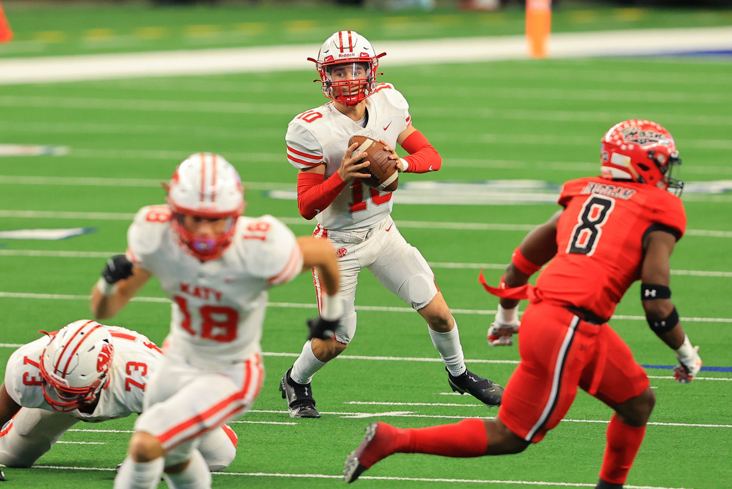 Katy High sophomore quarterback Caleb Koger (10) looks downfield during the Tigers' 51-14 Class 6A-Division II state championship win over Cedar Hill on Saturday, Jan. 16, at AT&T Stadium in Arlington.