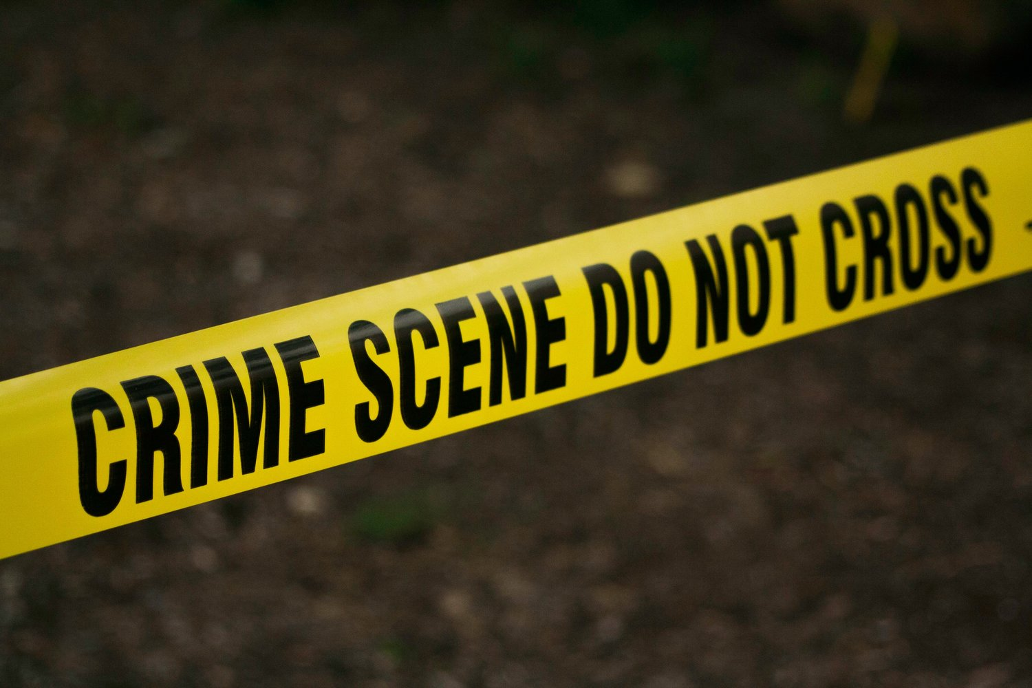 A man has died and his son has been injured after an unknown assailant or assailants fired into his apartment, striking him three times and his five-year-old son once.