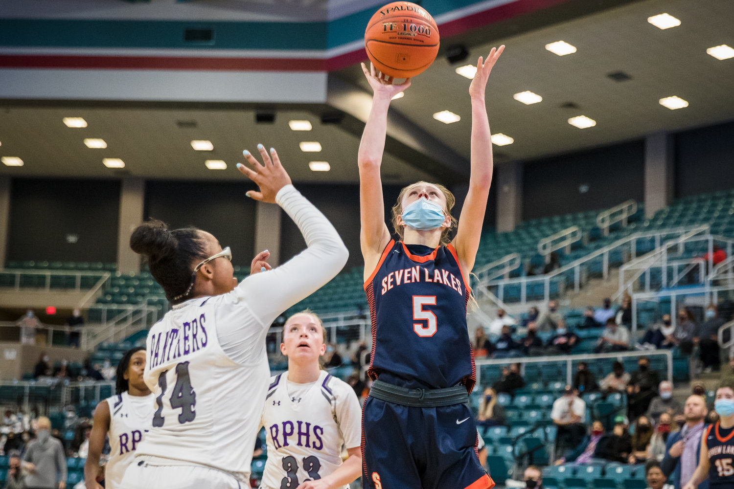 Seven Lakes' Lily Baumgardner (5) shoots over Fort Bend Ridge Point's Aleighyah Fontenot (14) during Thursday's Region III Class 6A bi-district playoff game at the Merrell Center in Katy.