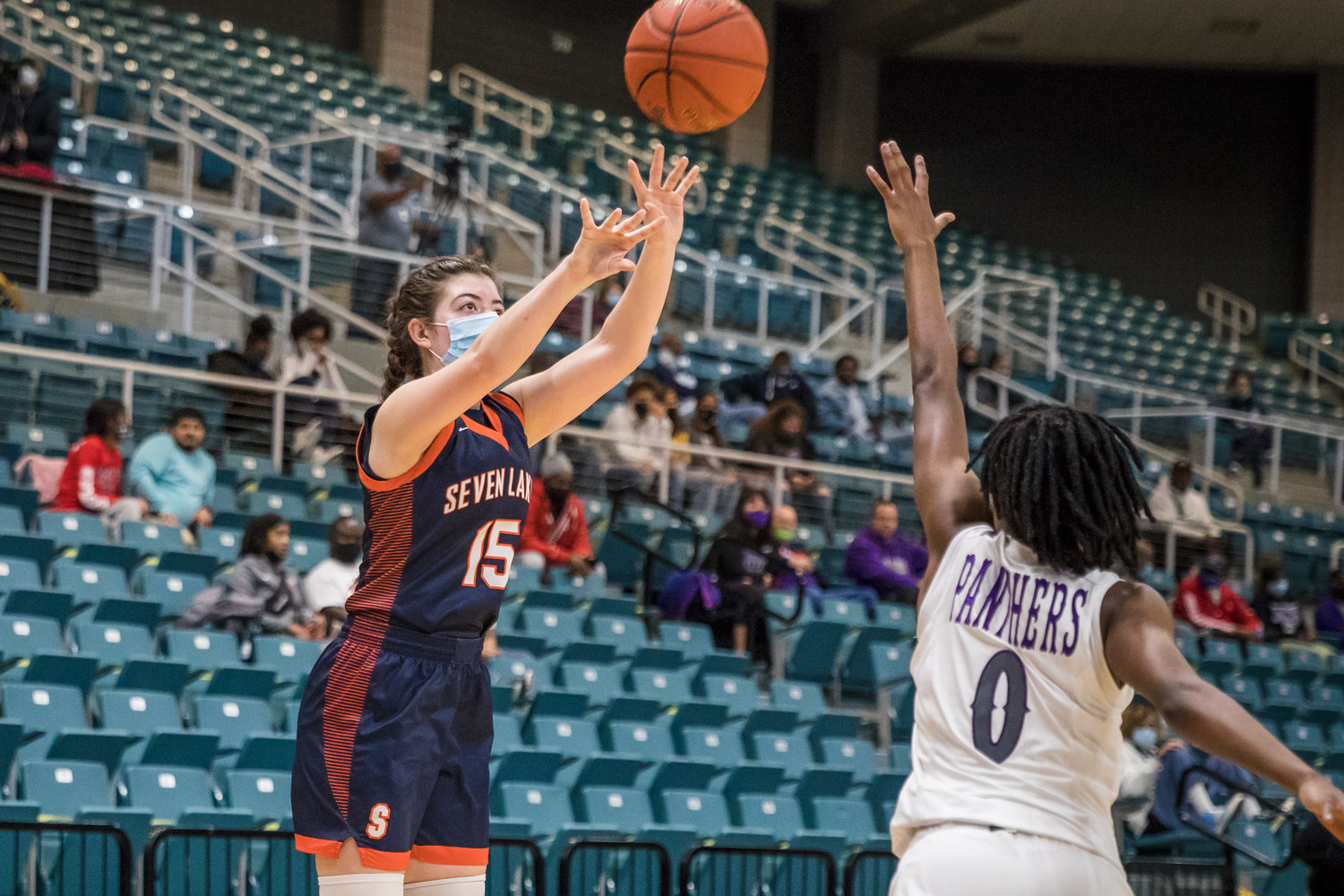 Seven Lakes' Sarah Narum (15) shoots a three-pointer over Fort Bend Ridge Point's Raven Adams (0) during Thursday's Region III Class 6A bi-district playoff game at the Merrell Center in Katy.