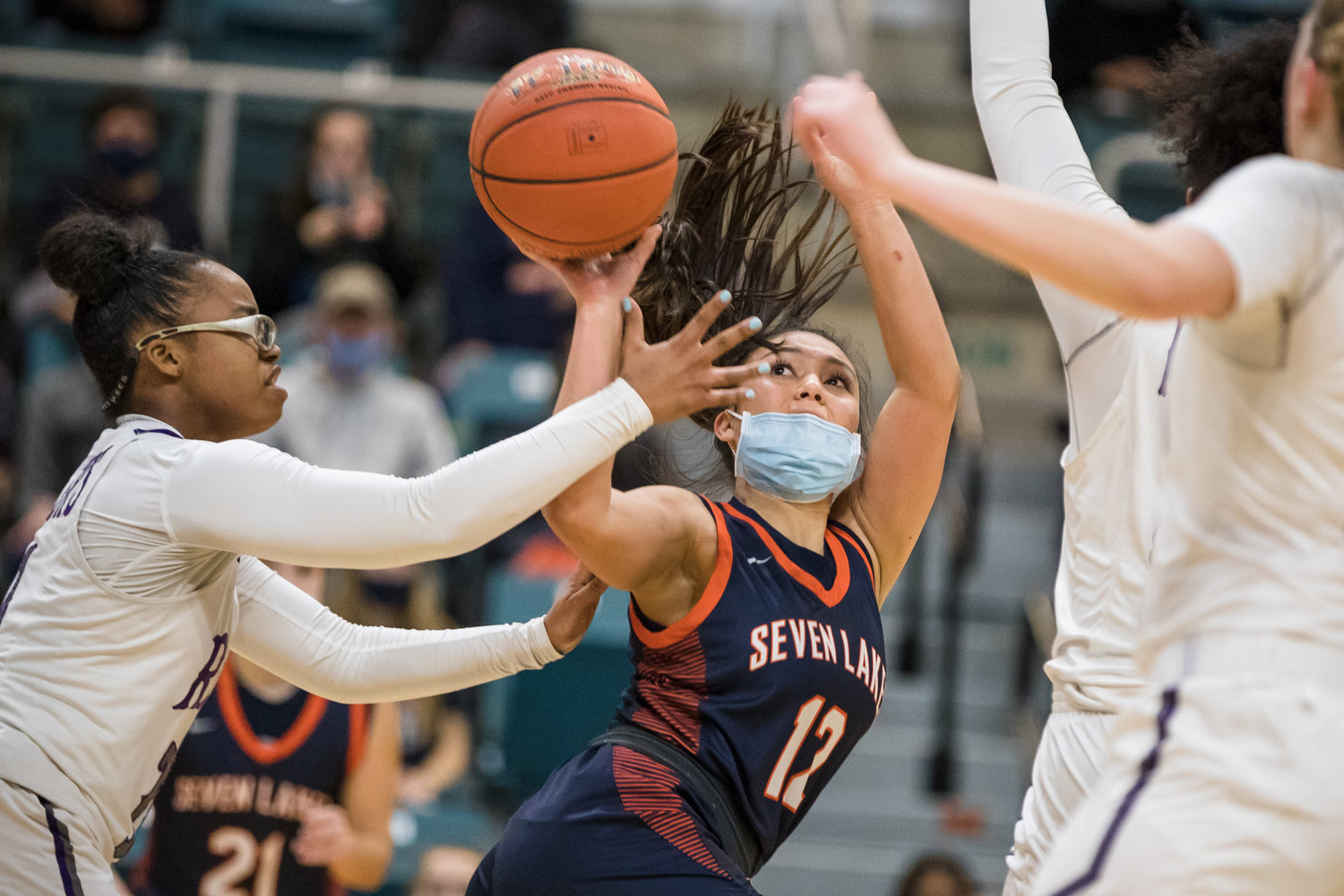 Seven Lakes' Cailyn Tucker (12) shoots a runner in the lane during Thursday's Region III Class 6A bi-district playoff game against Fort Bend Ridge Point at the Merrell Center in Katy.