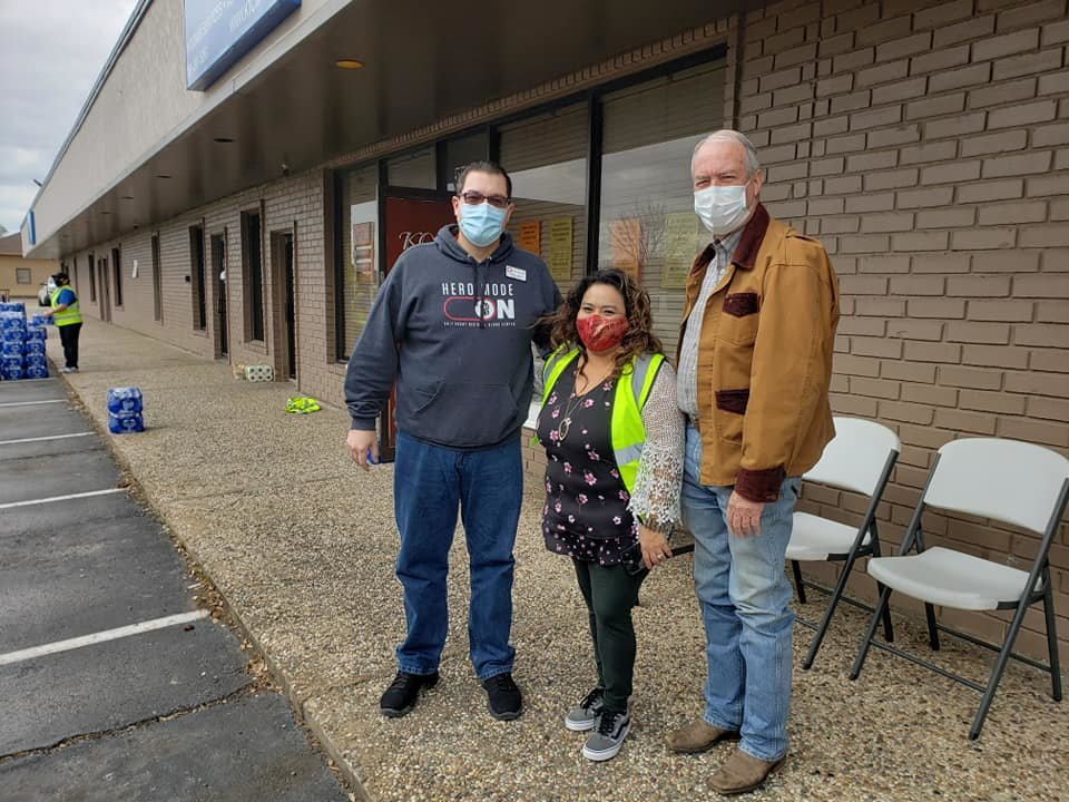 Katy Mayor Pro Tem Chris Harris (left), Katy Christian Ministries Executive Director Deysi Crespo (center) and Katy Mayor Bill Hastings at a water distribution event held by KCM with the assistance of The Cajun Navy, a support group that has often aided the Katy area in times of need such as after Hurricane Harvey.