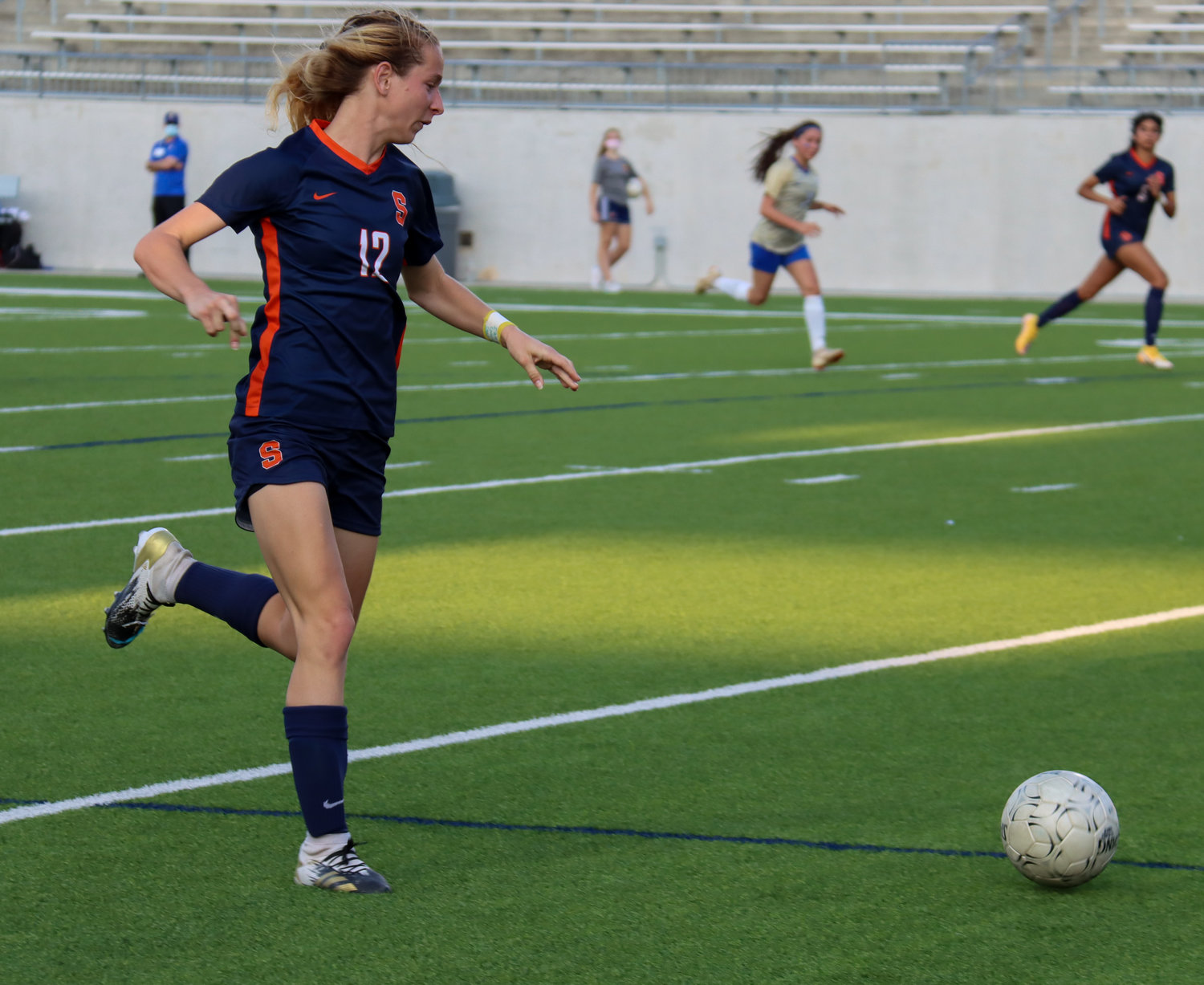 Seven Lakes senior forward Paige Boucher attacks downfield against an Elkins defender during the Spartans' 7-0 Class 6A bi-district playoff win on Friday, March 26, at Legacy Stadium.