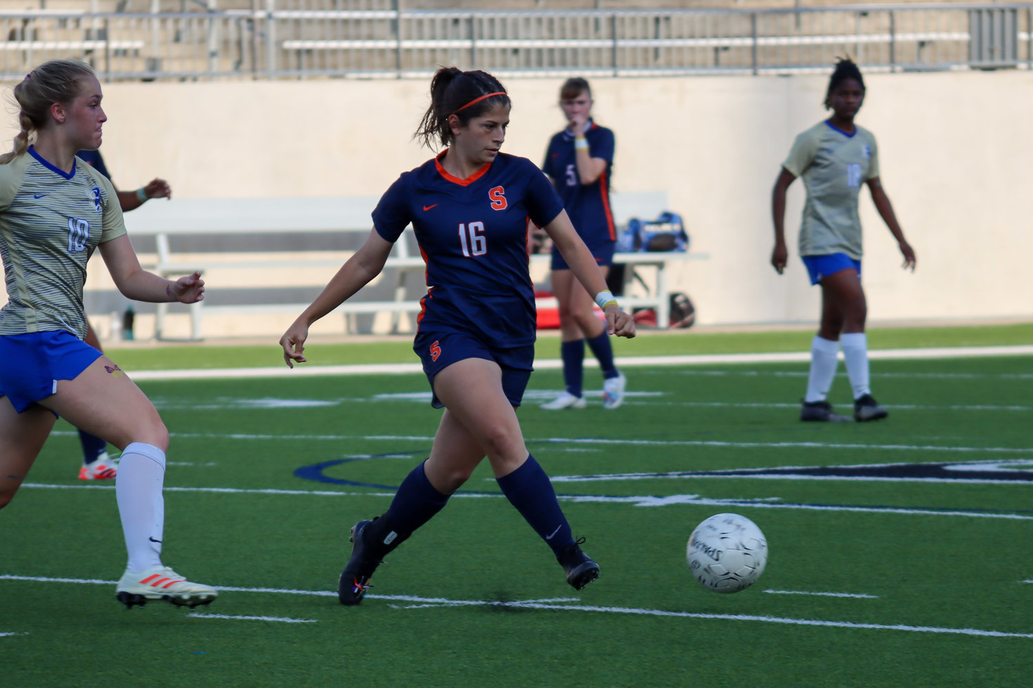 Seven Lakes senior midfielder Megan Vigil controls possession during the Spartans' 7-0 Class 6A bi-district playoff win on Friday, March 26, at Legacy Stadium.