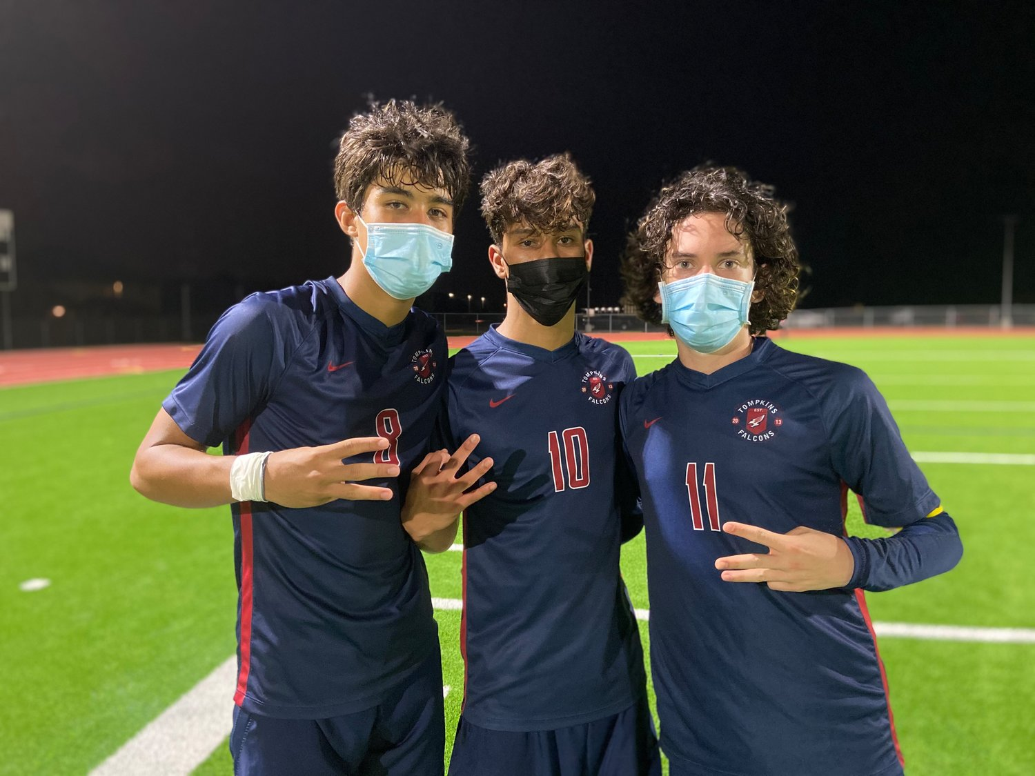 From left to right, Tompkins junior midfielder Rafa Gonzales, sophomore midfielder Luis Lugo and senior midfielder Jose Ojeda lifted the Falcons to a 4-2 Class 6A area playoff win over Cy-Fair on Tuesday, March 30, at Jordan High School.