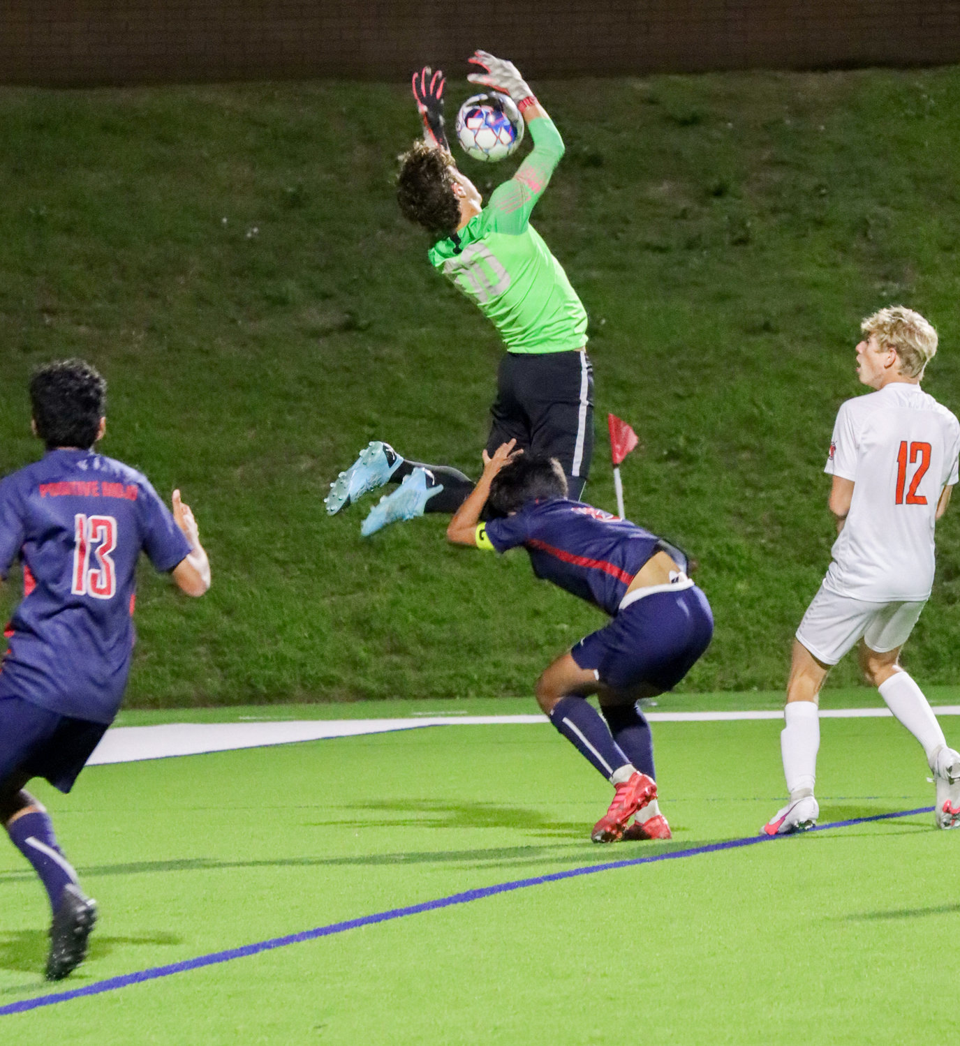 Tompkins senior goalkeeper Paulo Valente goes up for a save during the Falcons' Class 6A regional quarterfinal win over Seven Lakes on Friday, April 2, at Rhodes Stadium.
