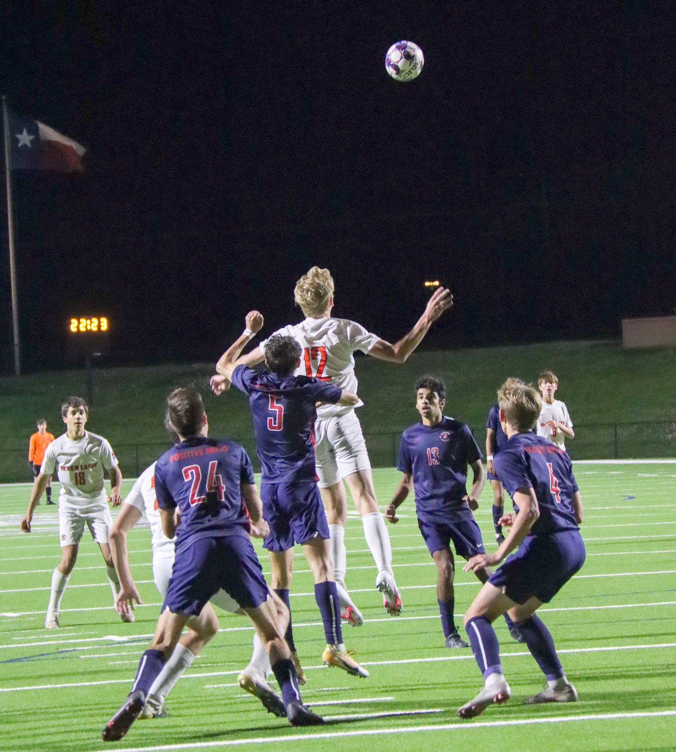 Tompkins defenders Ian Aumagher (24), Diego Castellano (5), Ojas Shandilya (13) and Luke Andrepont (4) swarm Seven Lakes sophomore midfielder Hunter Merritt (12) during their Class 6A regional quarterfinal game Friday, April 2, at Rhodes Stadium.