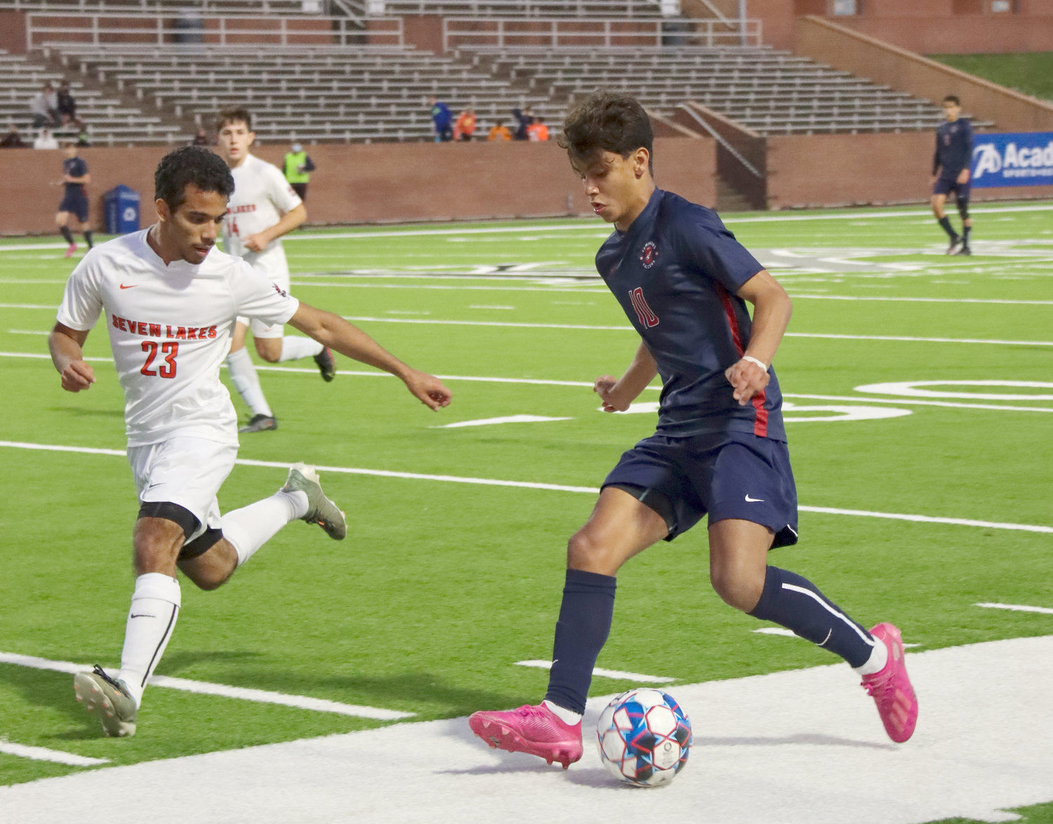 Tompkins sophomore Luis Lugo (10) takes on a Seven Lakes defender during their Class 6A regional quarterfinal game Friday, April 2, at Rhodes Stadium.