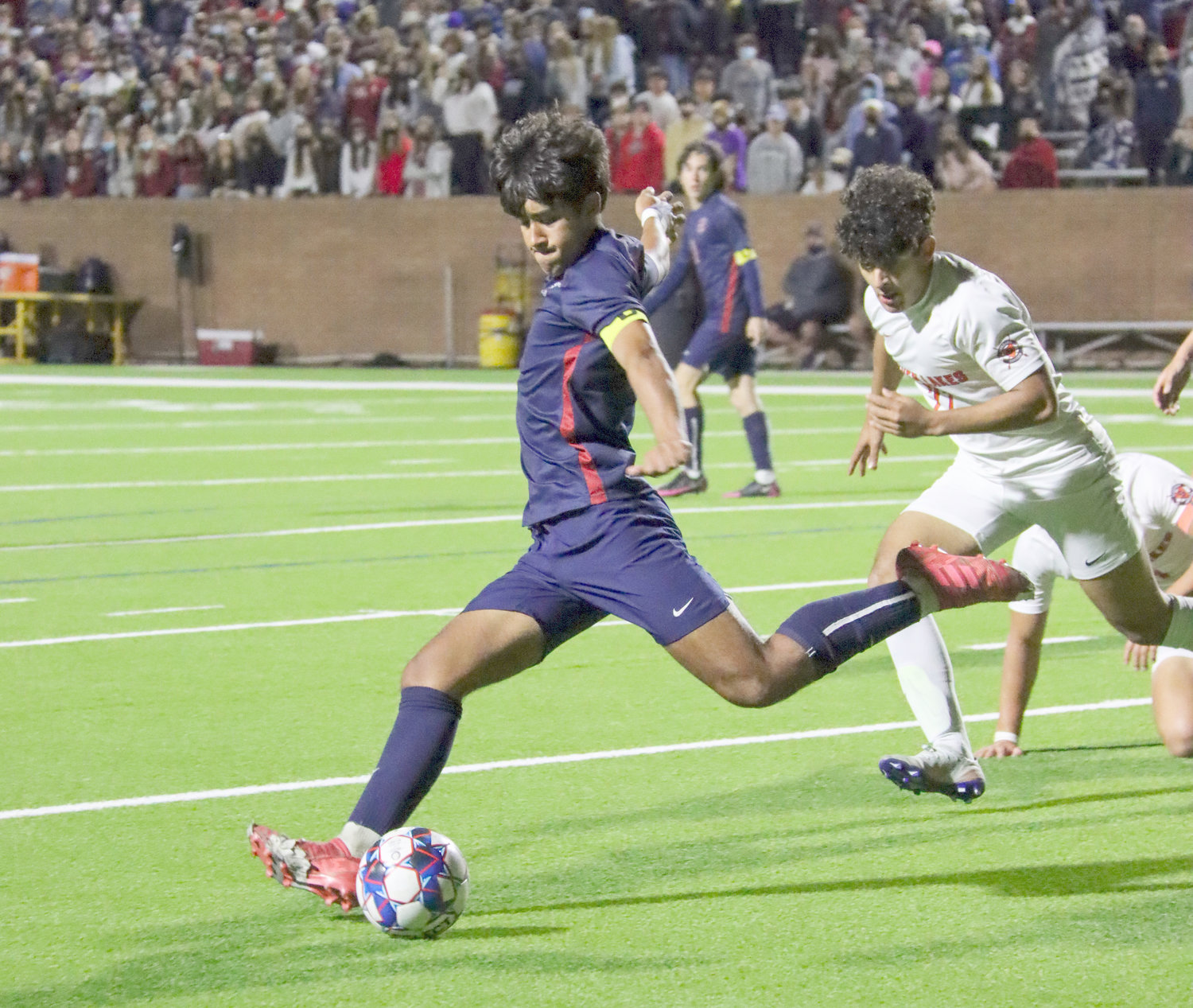 Tompkins junior Rafa Gonzales (8) prepares to kick the ball downfield during the Falcons' Class 6A regional quarterfinal win over Seven Lakes on Friday, April 2, at Rhodes Stadium.