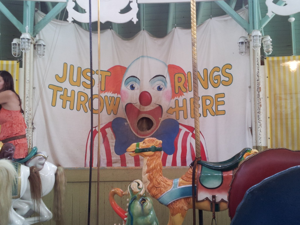 Generations have tried to get the brass ring for a free ride as they toss rings into the clown's mouth.