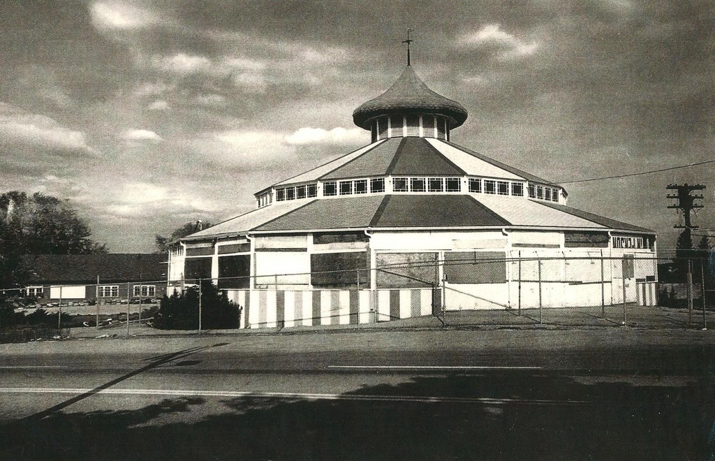 Sadly, a boarded up and fenced in Loof Carousel in 1980.