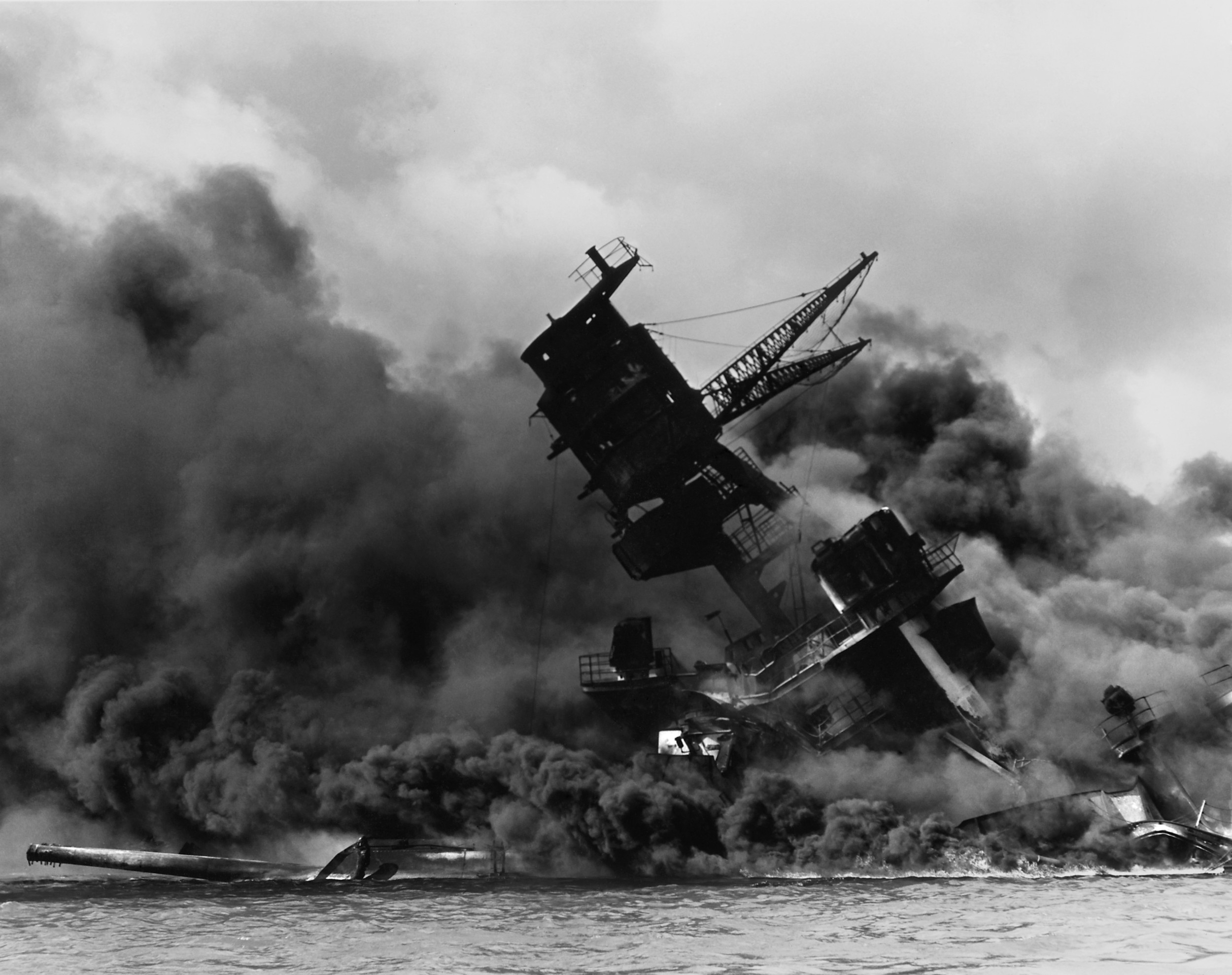 The USS Arizona burning after the Japanese attacked Pearl Harbor in Hawaii