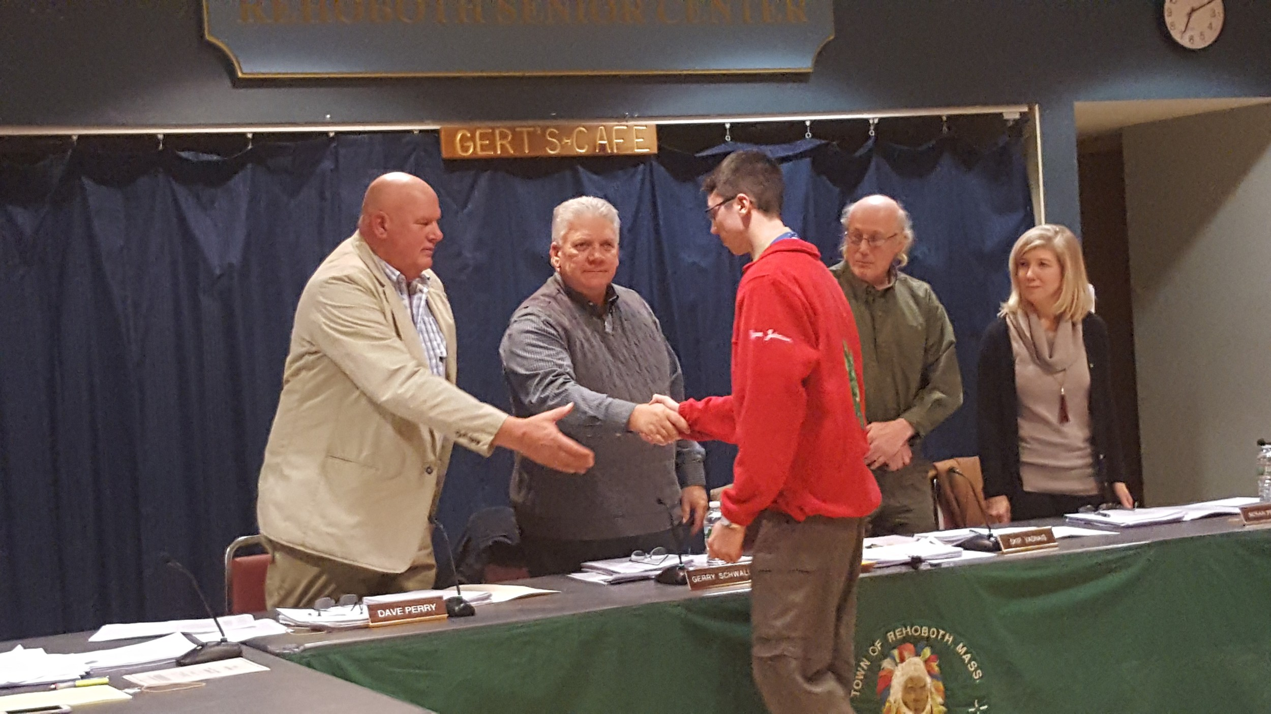 Eagle Scout Ryan Johnson is congratulated by the Board of Selectmen