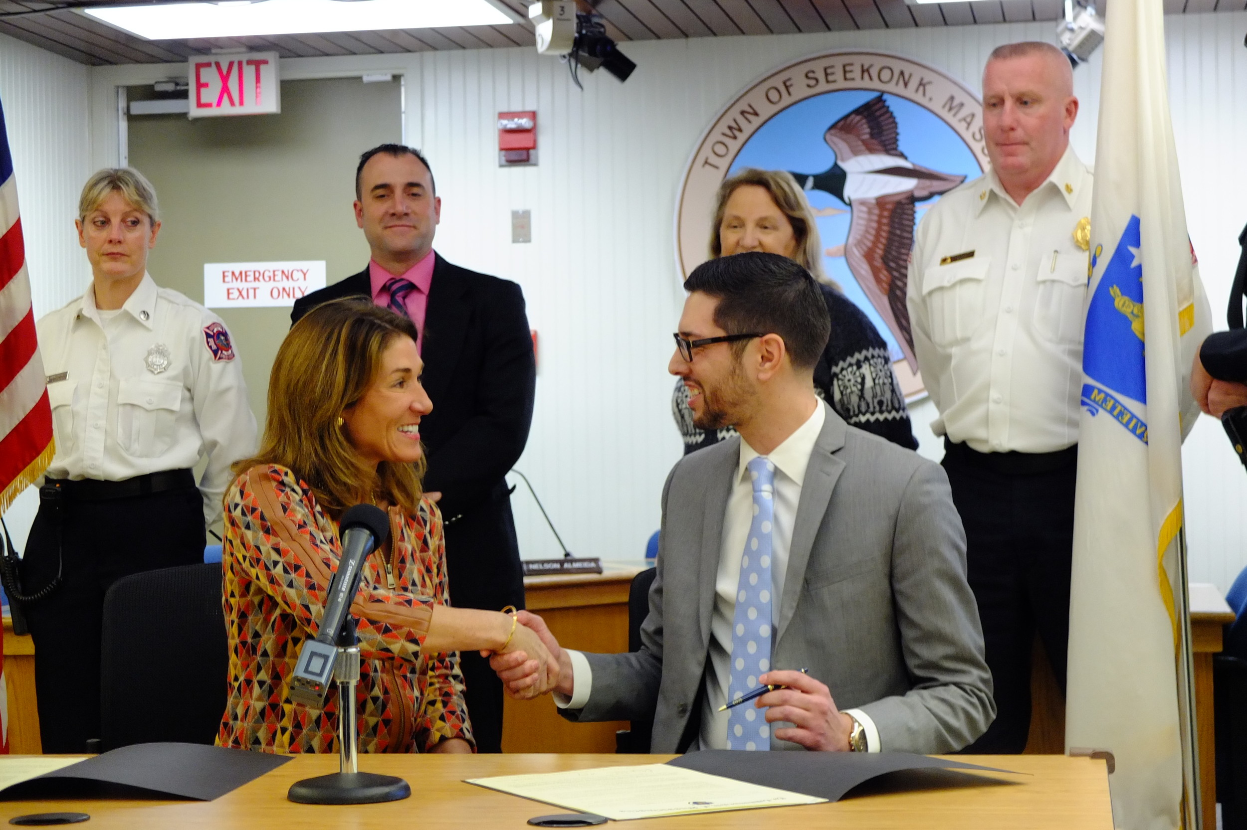 Rehoboth Signs Community Compact: Seekonk Town Administrator Shawn Cadime shakes hands with Lt. Governor Karyn Polito after signing the Community Compact.  Standing behind them are (L to R) Seekonk FIre Capt. Sandra Miller, Seekonk Selectman Nelson Almeida, Seekonk Selectwoman Michelle Hines, and Seekonk Fire Chief Michael Healy.