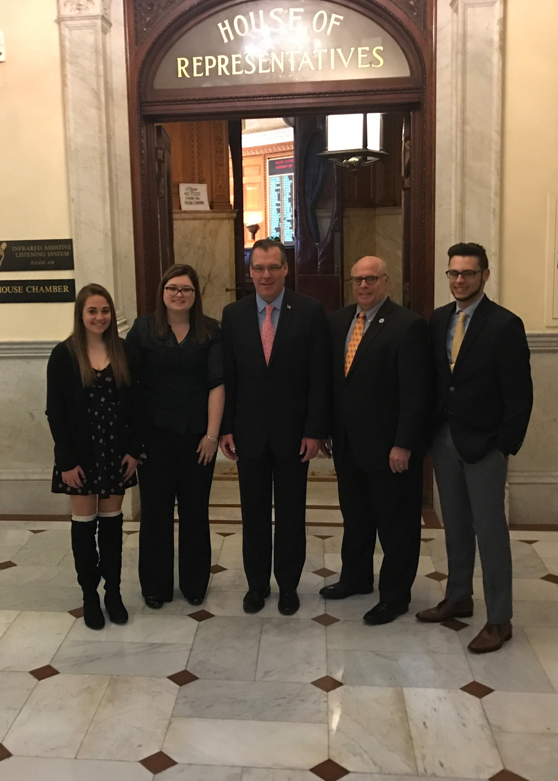 Abigail Martin and Robert Portway of Norton HS; Emma Johnson of Bristol Plymouth Reg. HS; Jackie Kucia of Dighton Rehoboth Reg. HS with JT and Representative Howitt