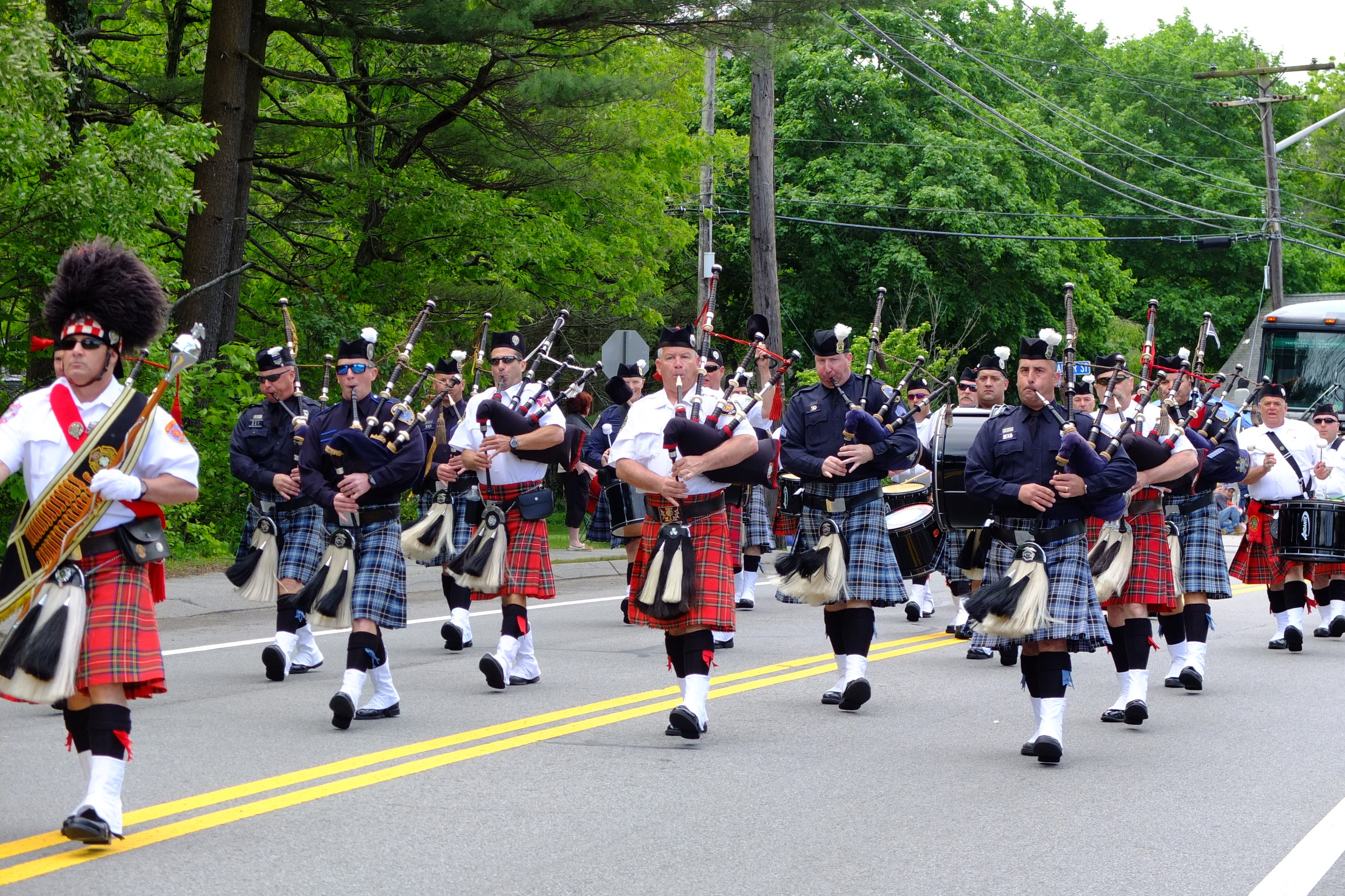 Police and Fire Department Bagpipers march in the parade.