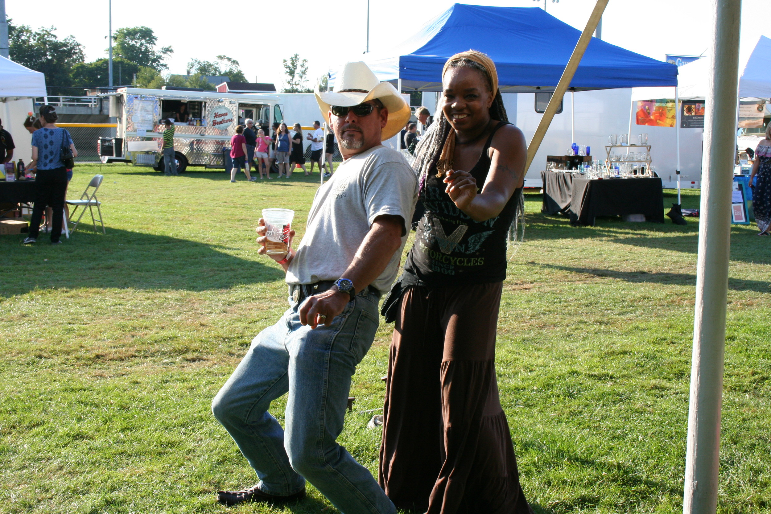 Justin Moan and Melanie Moore having some fun dancing with the music.