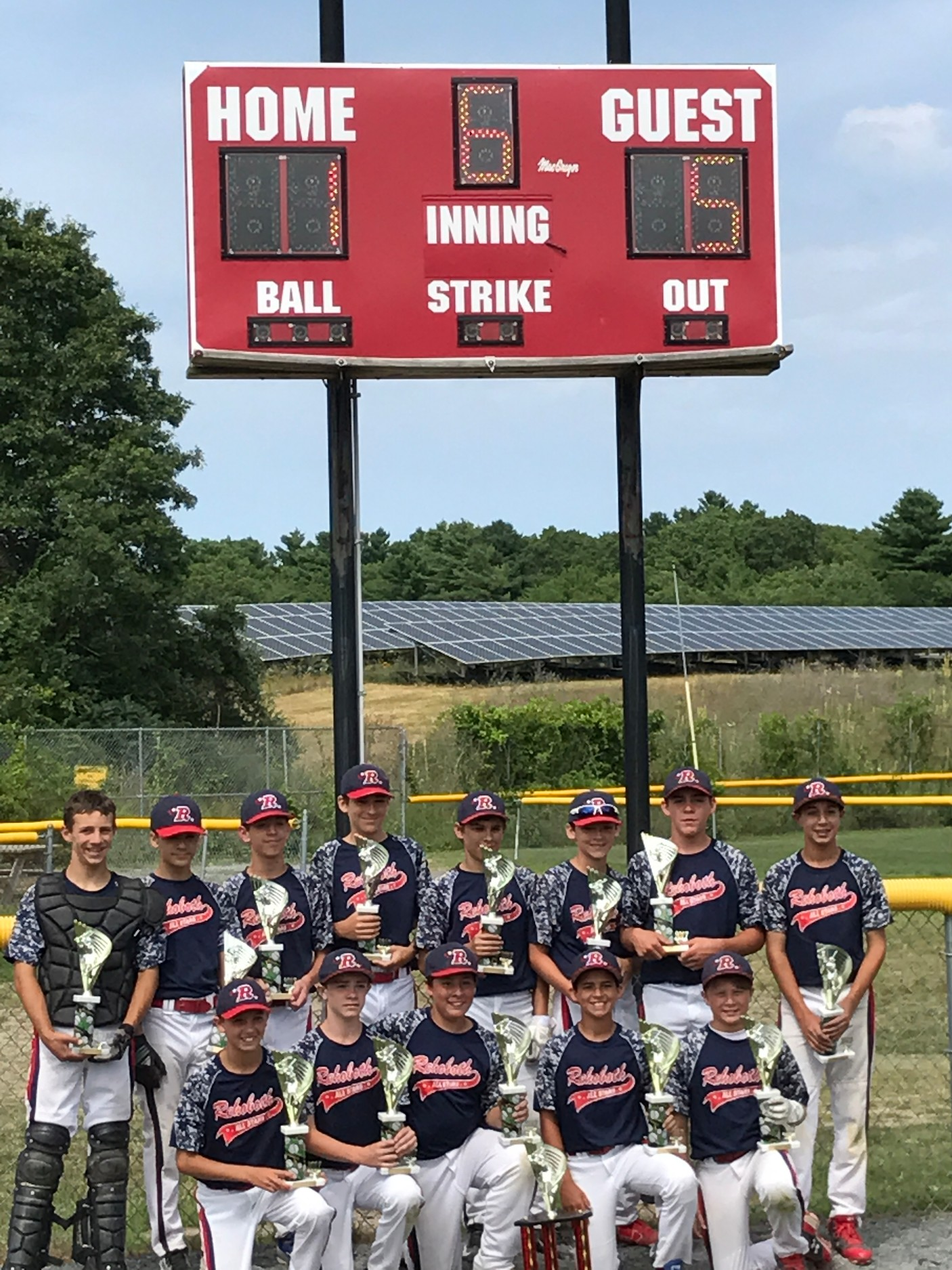 : Rehoboth 12U Players celebrate their first tournament win at their home field on Martin Street.