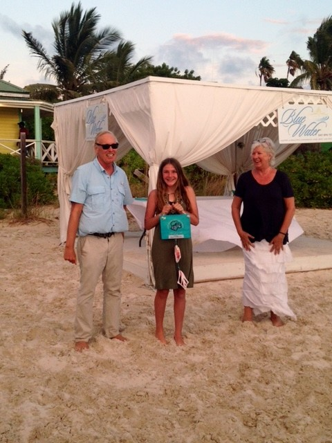 Amanda is awarded the 1st Place Trophy by Co-Directors of the Race for the Conch, Ben Stubenberg and Chloe Zimmerman