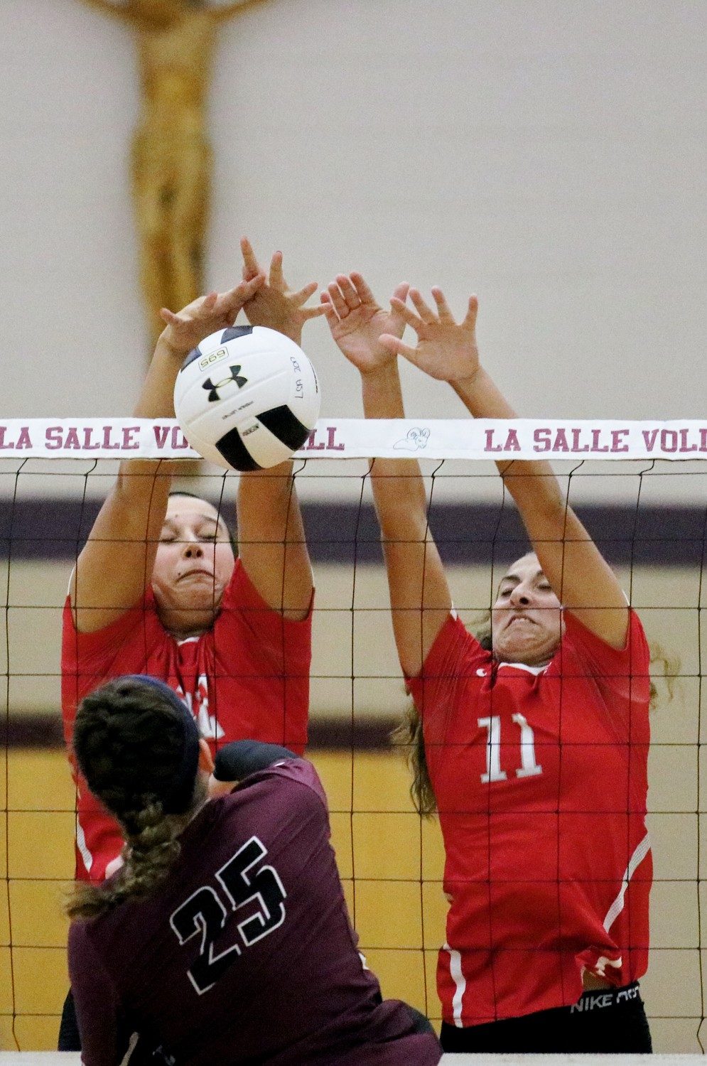 #22 Kate Mendillo and #11 Sadie Patterson block a ball vs LaSalle. Photo Paul Tumidajski.