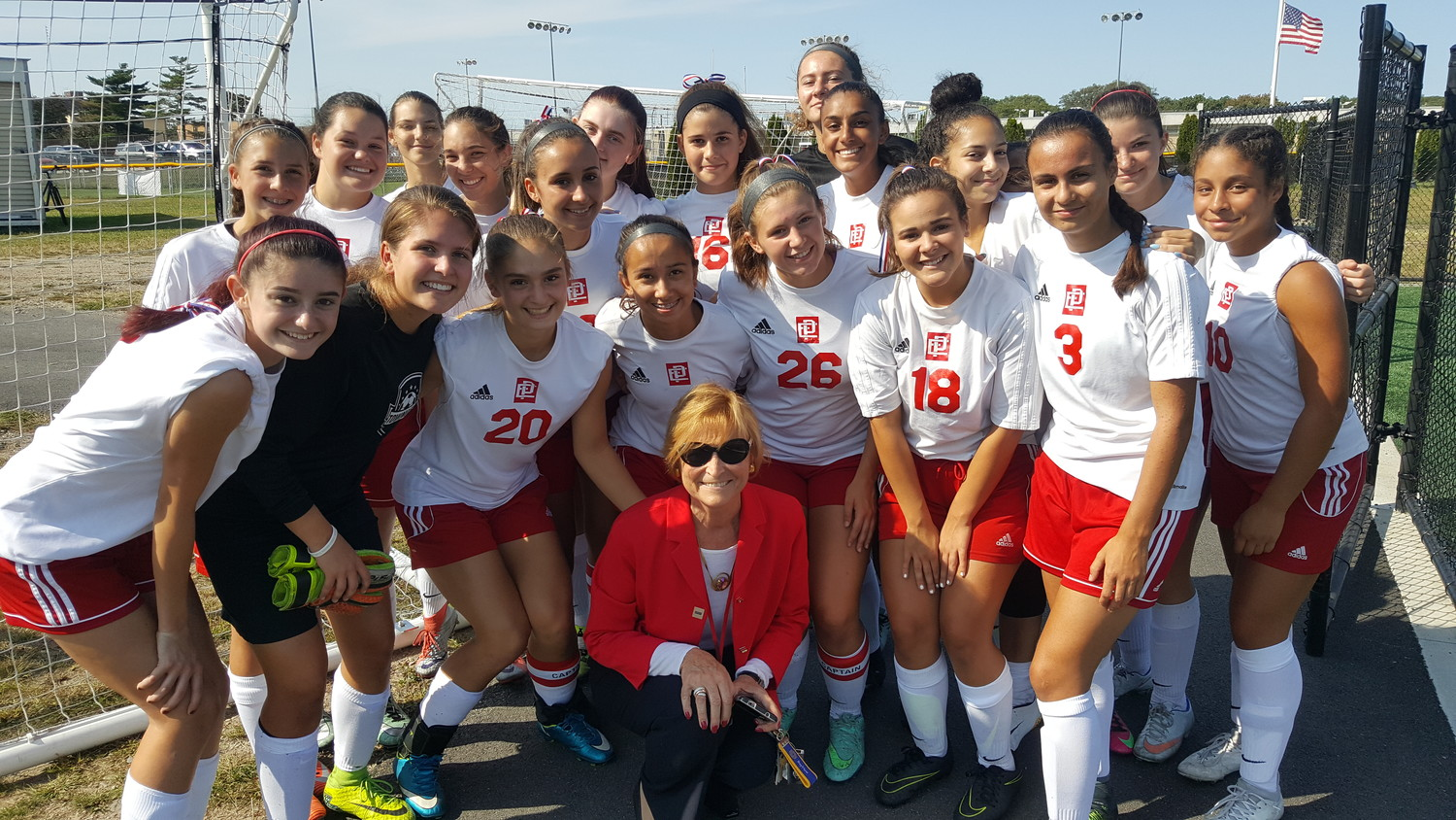 Superintendent of Schools Kathryn Crowley joins the EPHS girls soccer team in a tribute on September 11th.